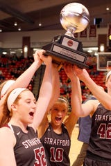The Strafford Lady Indians celebrate their Pink Division win against Mt Vernon at Drury on December 29, 2018.