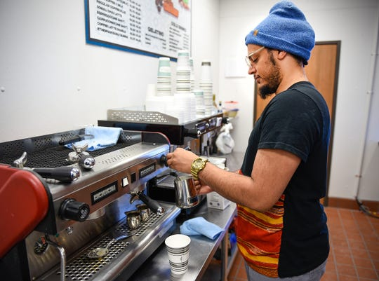 Muhsin Abdulkadir creates a coffee drink for a customer Saturday, Dec. 29, at the new Nori Cafe & Creamery, located at 510-25th Ave. N., Suite B4 in St. Cloud.