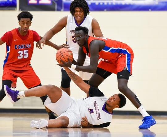 St. Cloud Apollo's Deng Diew steals the ball from Milwaukee Washington's Deontay Long during the first half Saturday, Dec. 29, in the Breakdown Granite City Classic basketball tournament at Apollo High School.