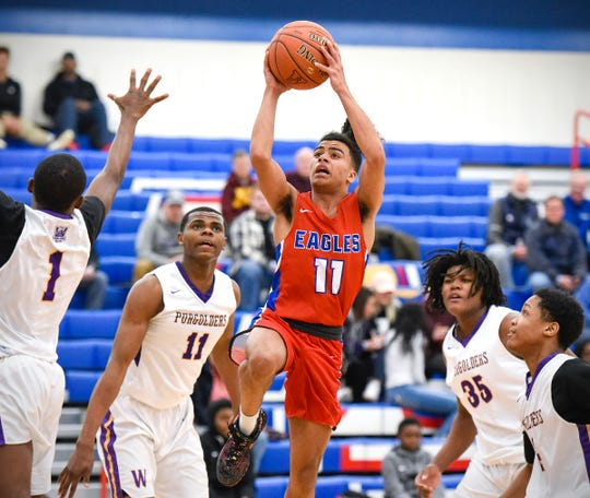 Apollo's Michael Gravelle shoots against Milwaukee Washington during the first half Saturday, Dec. 29, 2018, in the Breakdown Granite City Classic basketball tournament at Apollo High School.