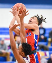 St. Cloud Apollo's Michael Gravelle takes a shot against Milwaukee Washington during the first half Saturday, Dec. 29, 2018, in the 2018 Breakdown Granite City Classic basketball tournament at Apollo High School.