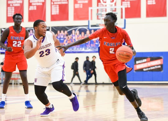 St. Cloud Apollo's Pouch Dobuol drives toward the basket past Milwaukee Washington's Johntae Martin during the first half Saturday, Dec. 29, 2018 in the 2018 Breakdown Granite City Classic basketball tournament at Apollo High School.