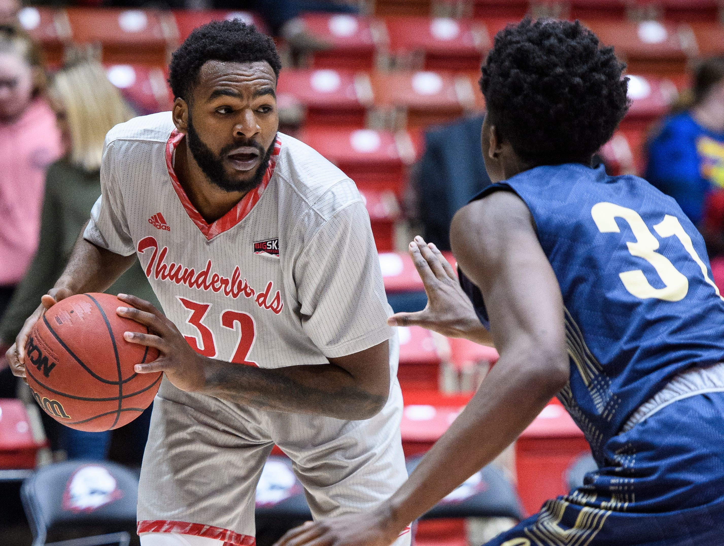 Southern Utah University junior Andre Adams (32) stares down Montana State University sophomore Devin Kirby (31) in the America First Event Center Saturday, December 29, 2018. SUU lost, 92-62.