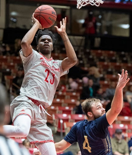Southern Utah University junior Cameron Oluyitan (23) takes a shot against Montana State in the America First Event Center Saturday, December 29, 2018.