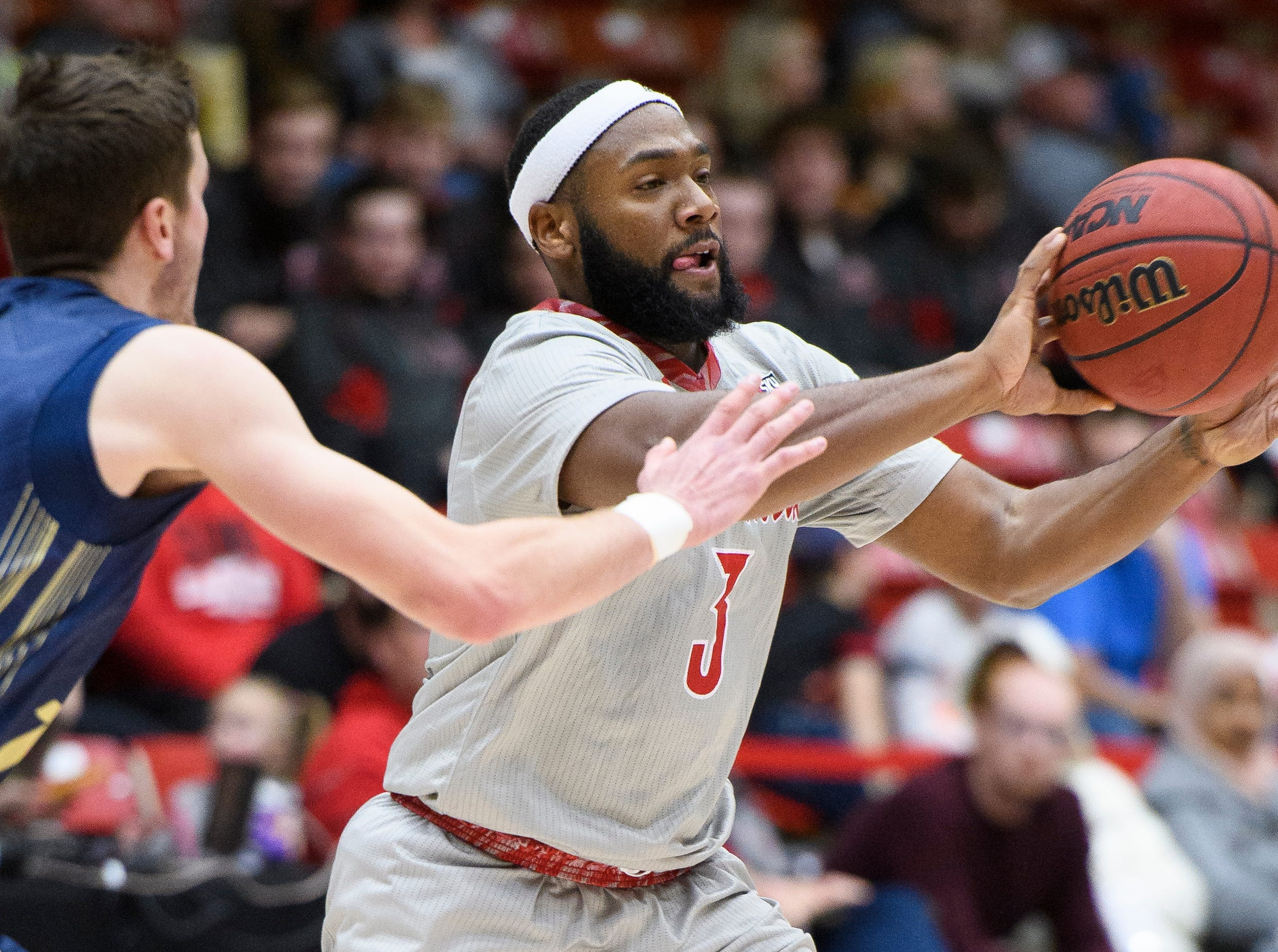 Southern Utah University junior Jason Richardson (3) passes the ball against Montana State in the America First Event Center Saturday, December 29, 2018. SUU lost, 92-62.