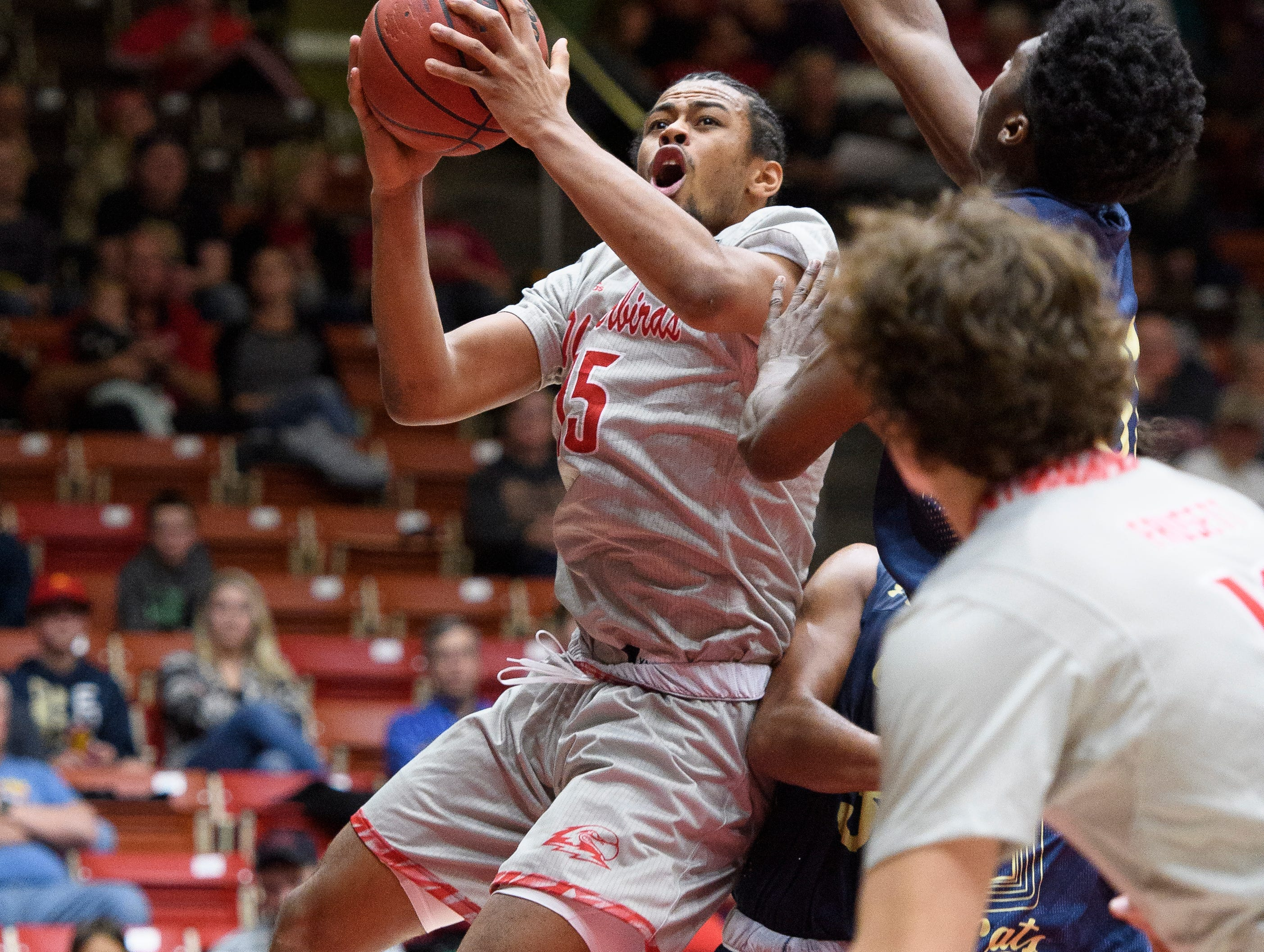Southern Utah University freshman Harrison Butler (15) takes a shot against Montana State in the America First Event Center Saturday, December 29, 2018. SUU lost, 92-62.