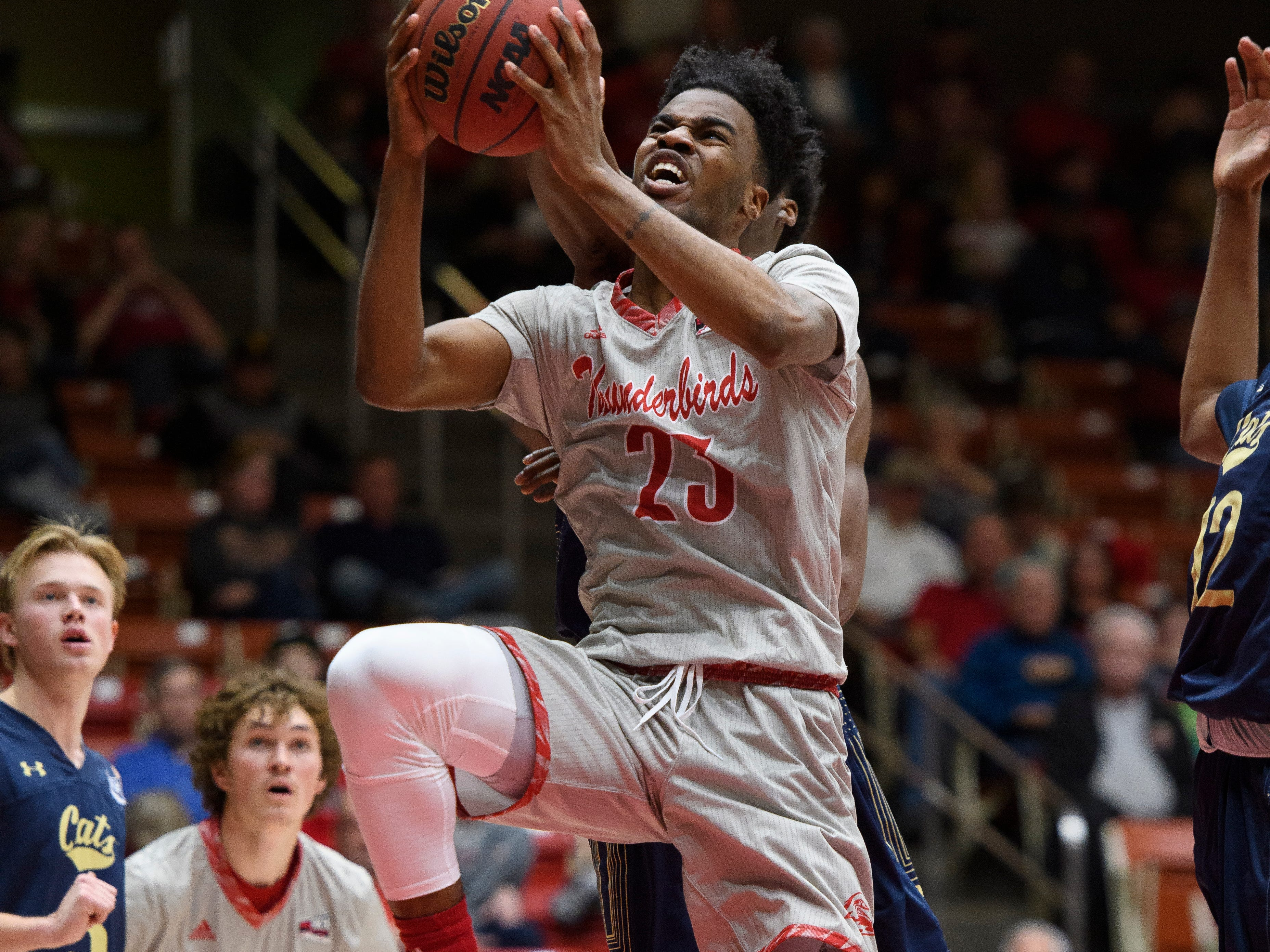 Southern Utah University junior Cameron Oluyitan (23) gets his shot blocked against Montana State in the America First Event Center Saturday, December 29, 2018. SUU lost, 92-62.