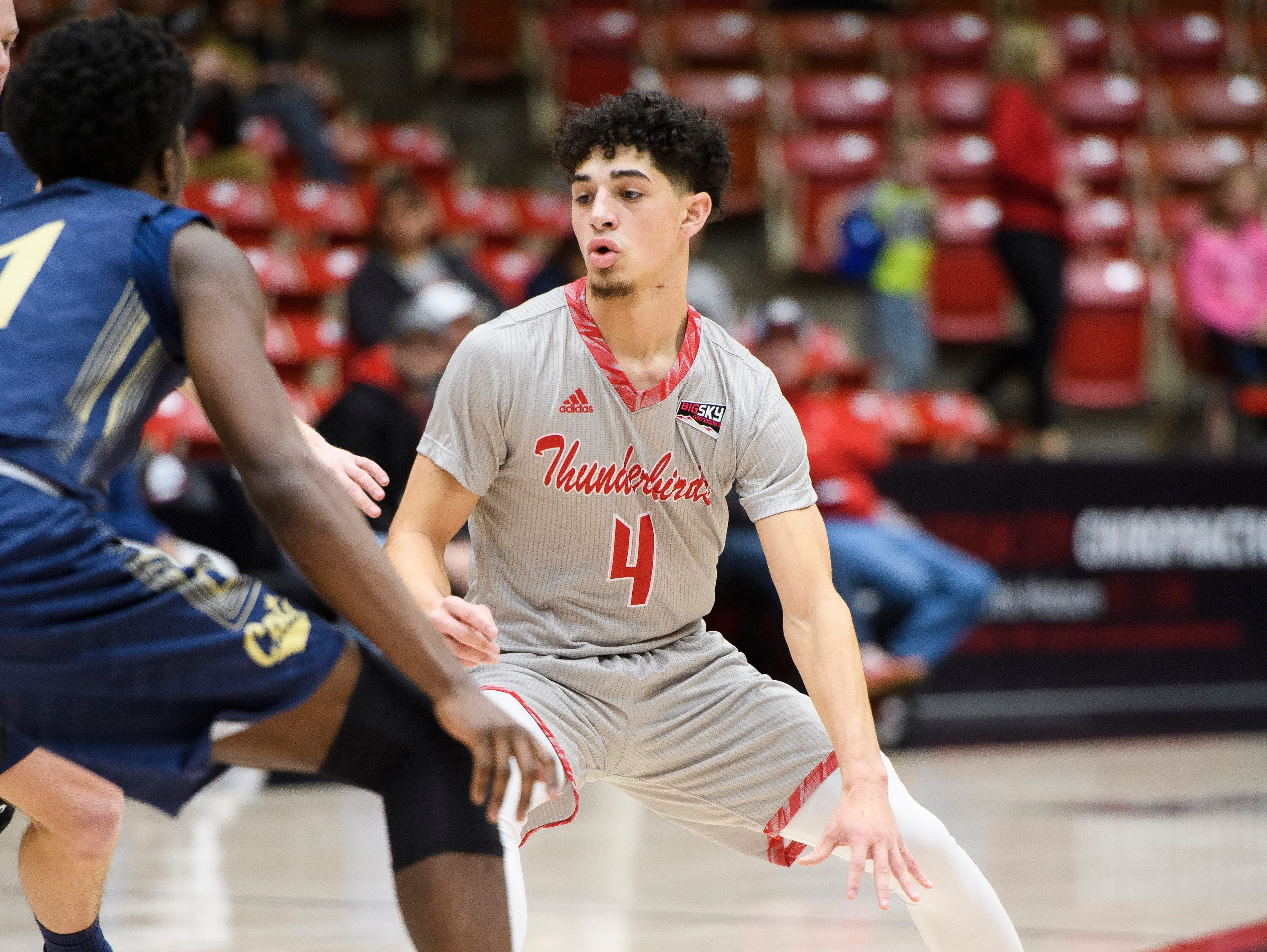 Southern Utah University sophomore Dre Marin (4) works a Montana State defender in the America First Event Center Saturday, December 29, 2018. SUU lost, 92-62.
