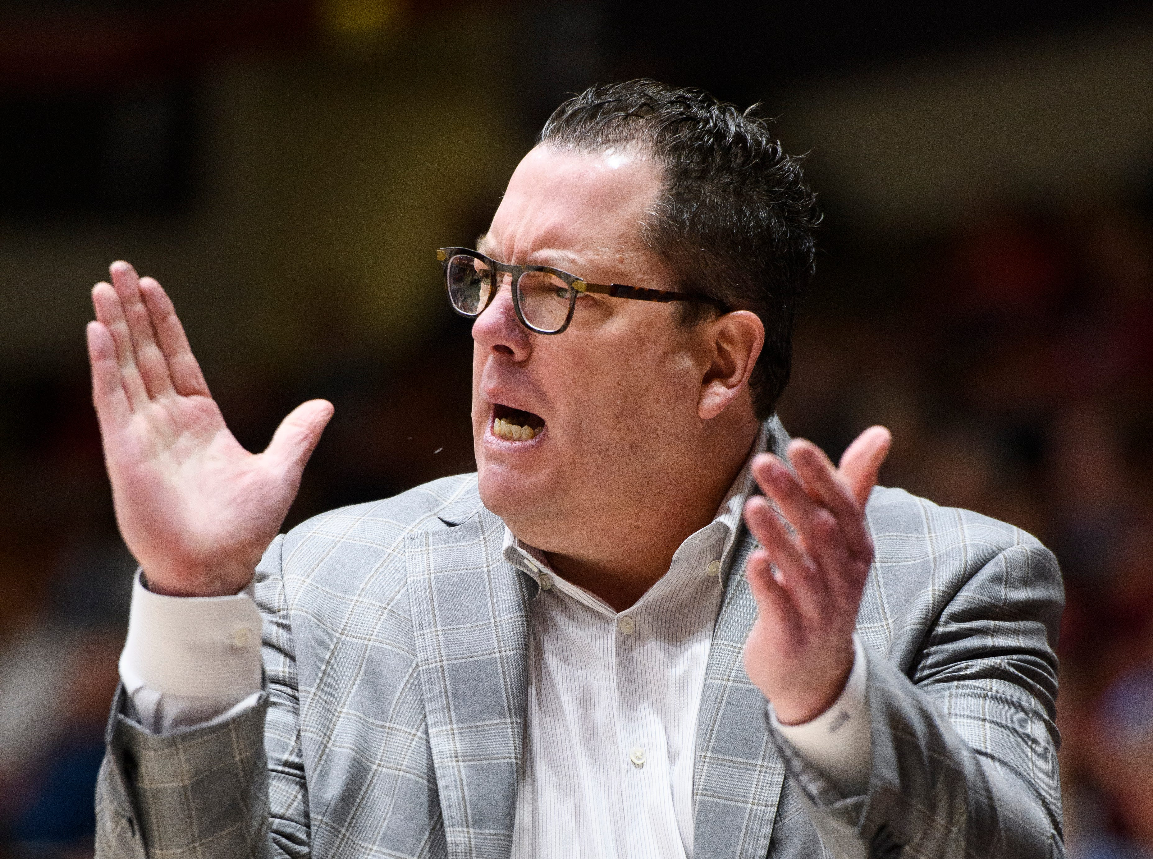 Montana State head coach Brian Fish encourages his team during the game against Southern Utah University in the America First Event Center Saturday, December 29, 2018. SUU lost, 92-62.
