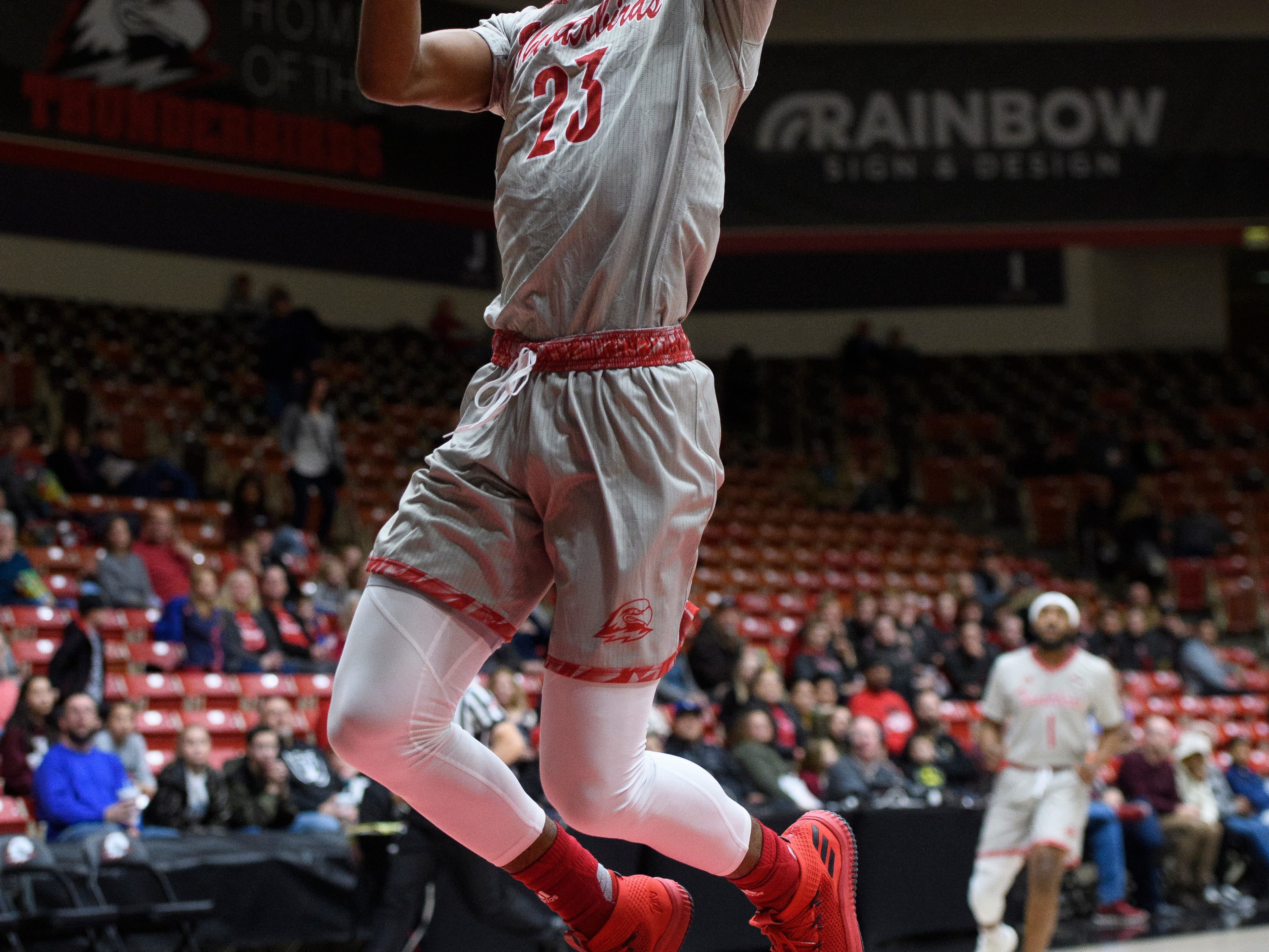 Southern Utah University junior Andre Adams (32) shoots a breakaway layup against Montana State in the America First Event Center Saturday, December 29, 2018. SUU lost, 92-62.