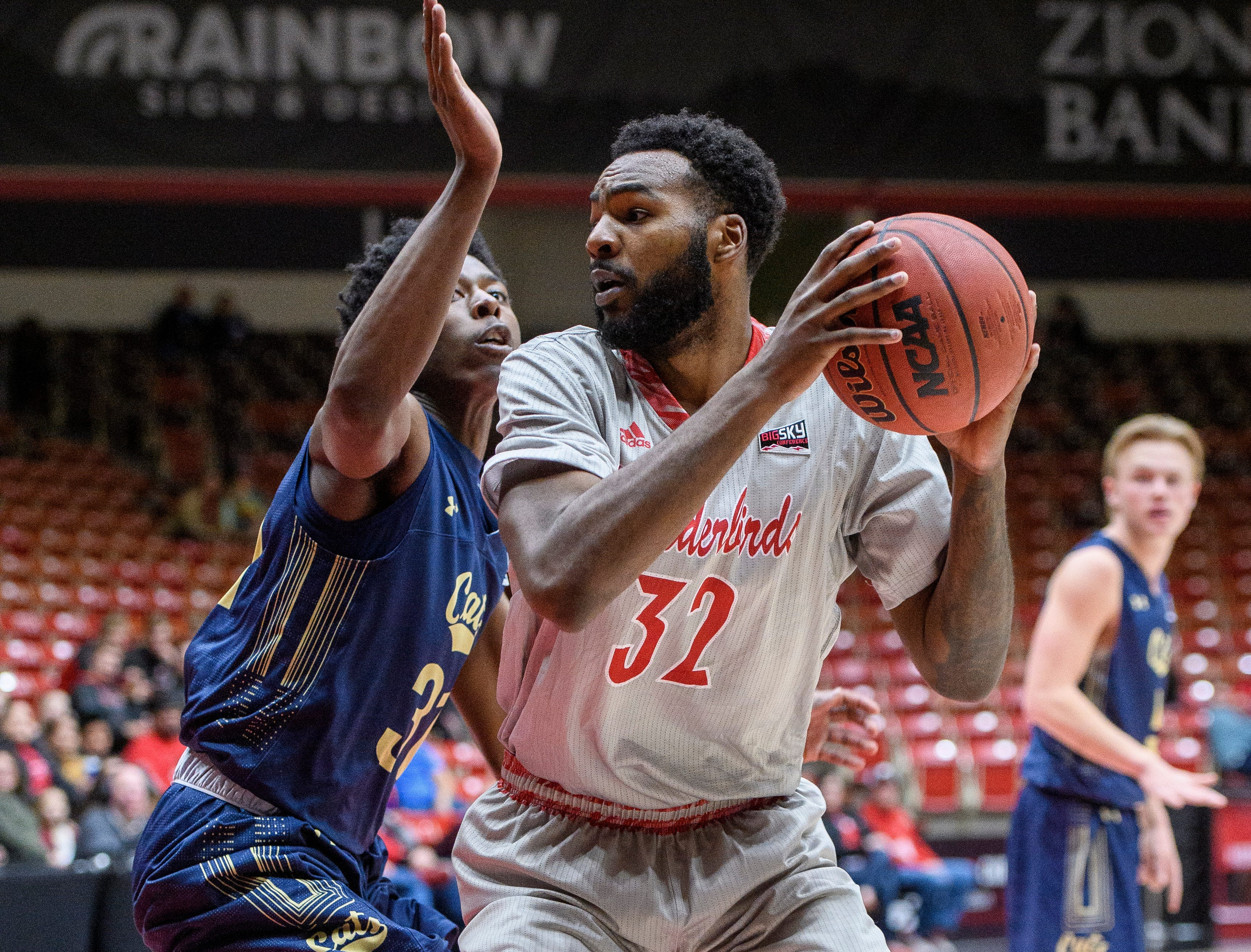 Southern Utah University junior Andre Adams (32) fights his way towards the basket during the game against Montana State in the America First Event Center Saturday, December 29, 2018. SUU lost, 92-62.