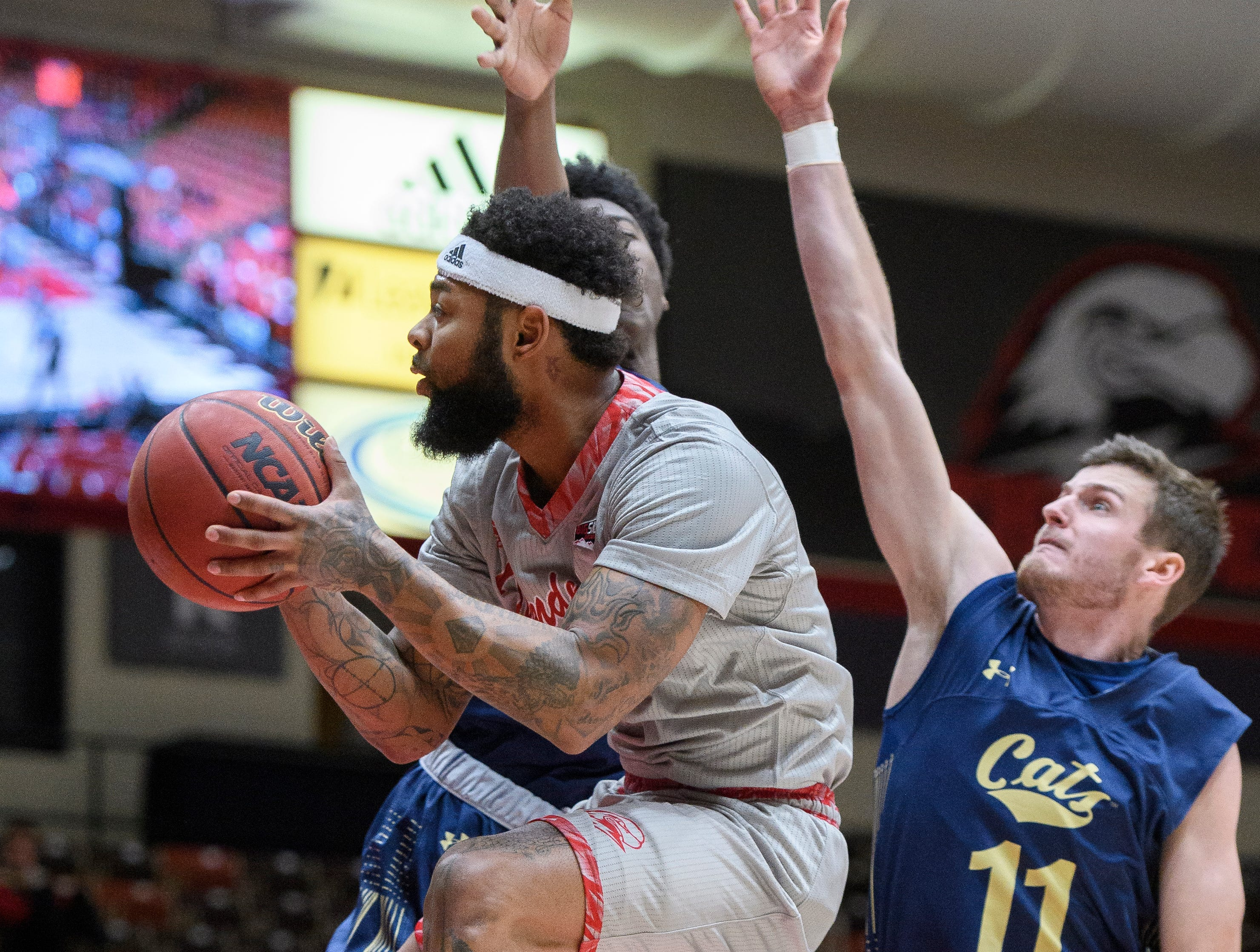 Southern Utah University junior Jason Richardson (3) bails out of a shot against Montana State in the America First Event Center Saturday, December 29, 2018. SUU lost, 92-62.