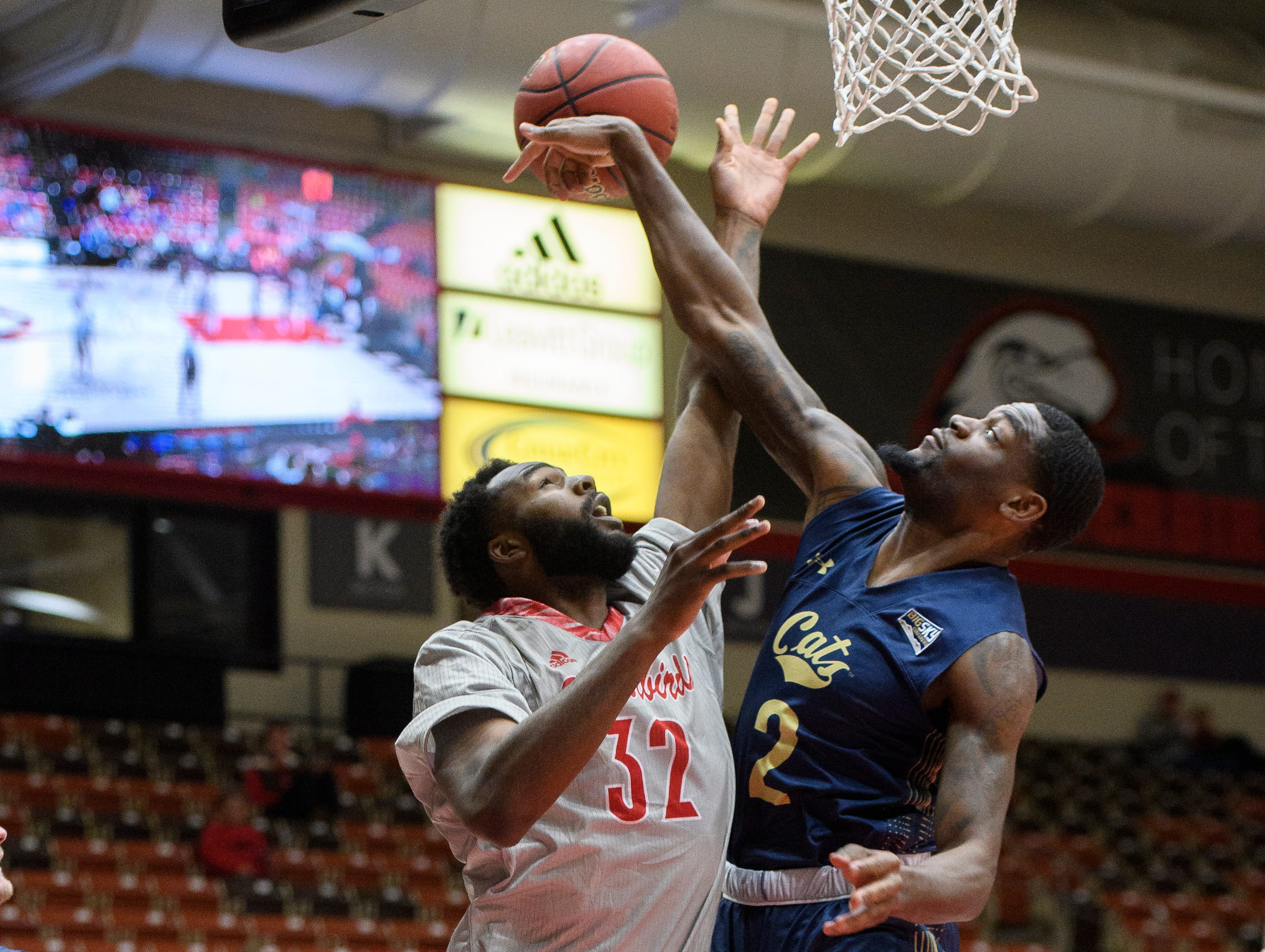 Montana State University senior Keljin Blevins (2) blocks the shot of Southern Utah University junior Andre Adams (32) in the America First Event Center Saturday, December 29, 2018. SUU lost, 92-62.