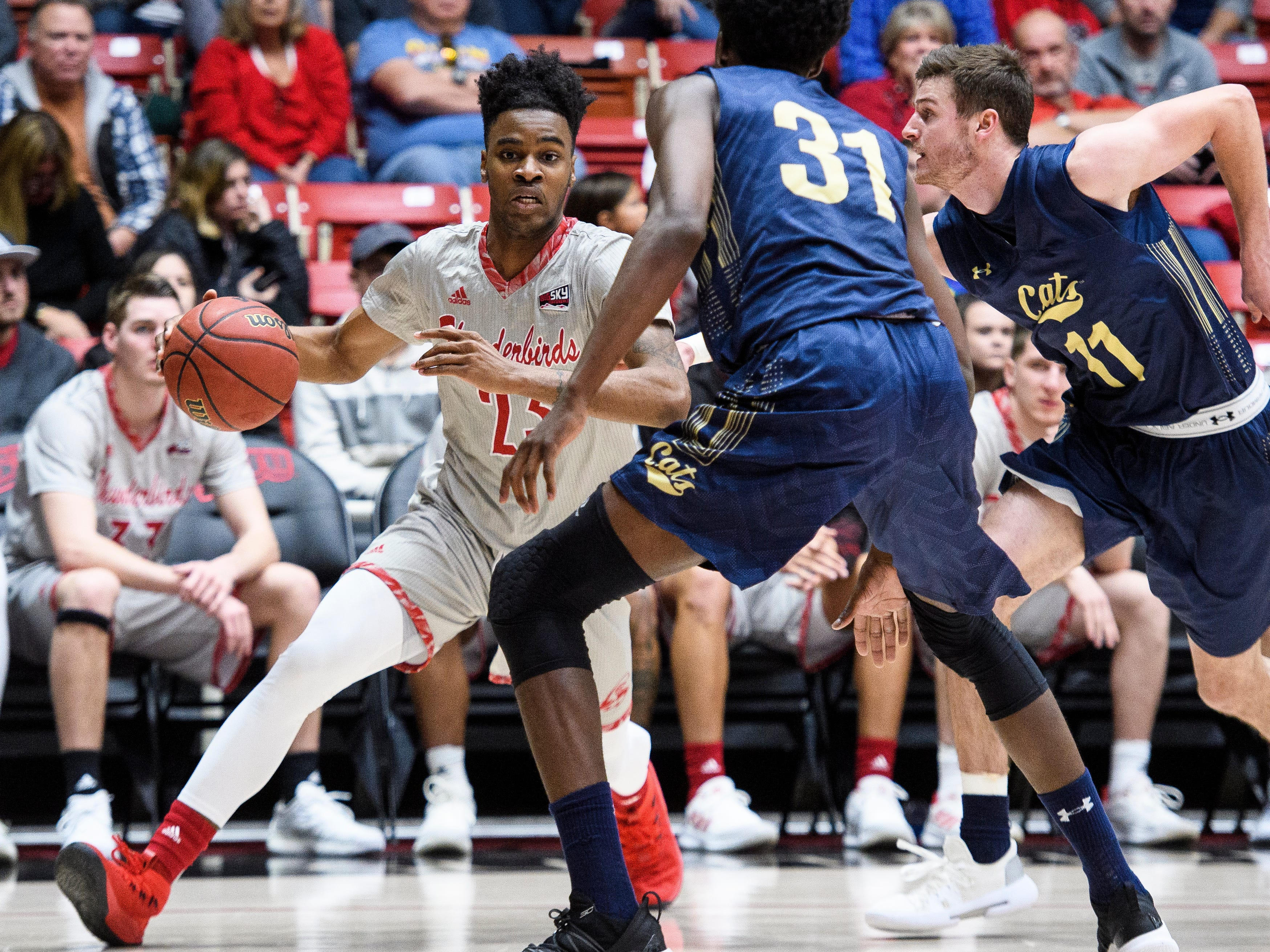 Southern Utah University junior Cameron Oluyitan (23) moves the ball against Montana State in the America First Event Center Saturday, December 29, 2018. SUU lost, 92-62.