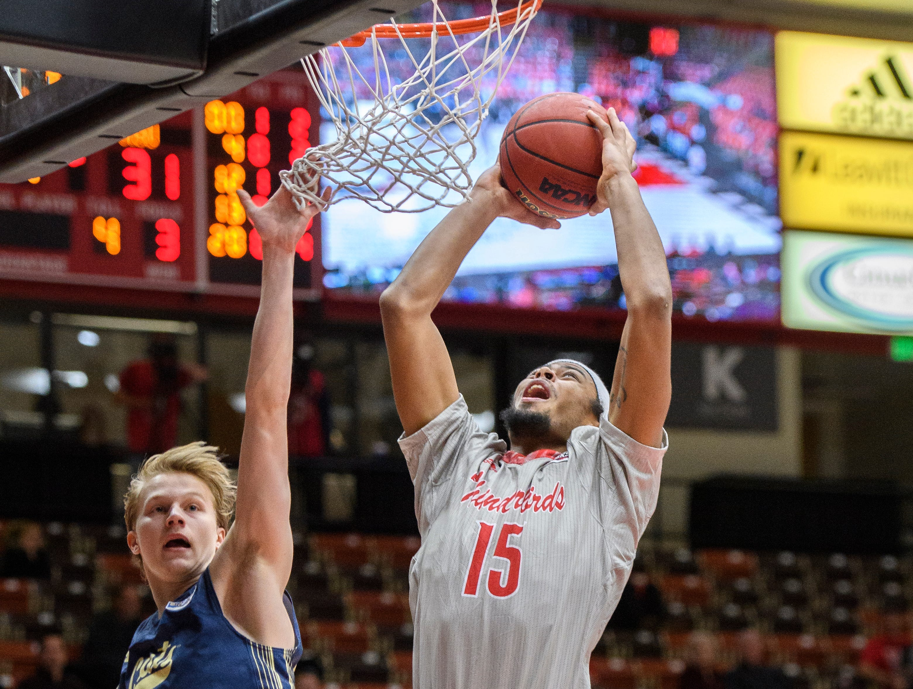 Southern Utah University freshman Harrison Butler (15) scores a basket against Montana State in the America First Event Center Saturday, December 29, 2018. SUU lost, 92-62.