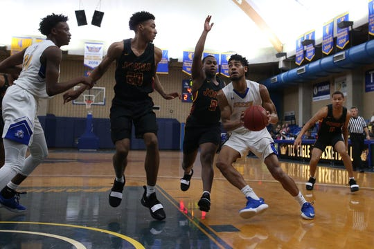 TCC's Devin Palmer drives inside the lane against Jones College. The Eagles defeated the Bobcats in the Tallahassee Democrat Holiday Classic.