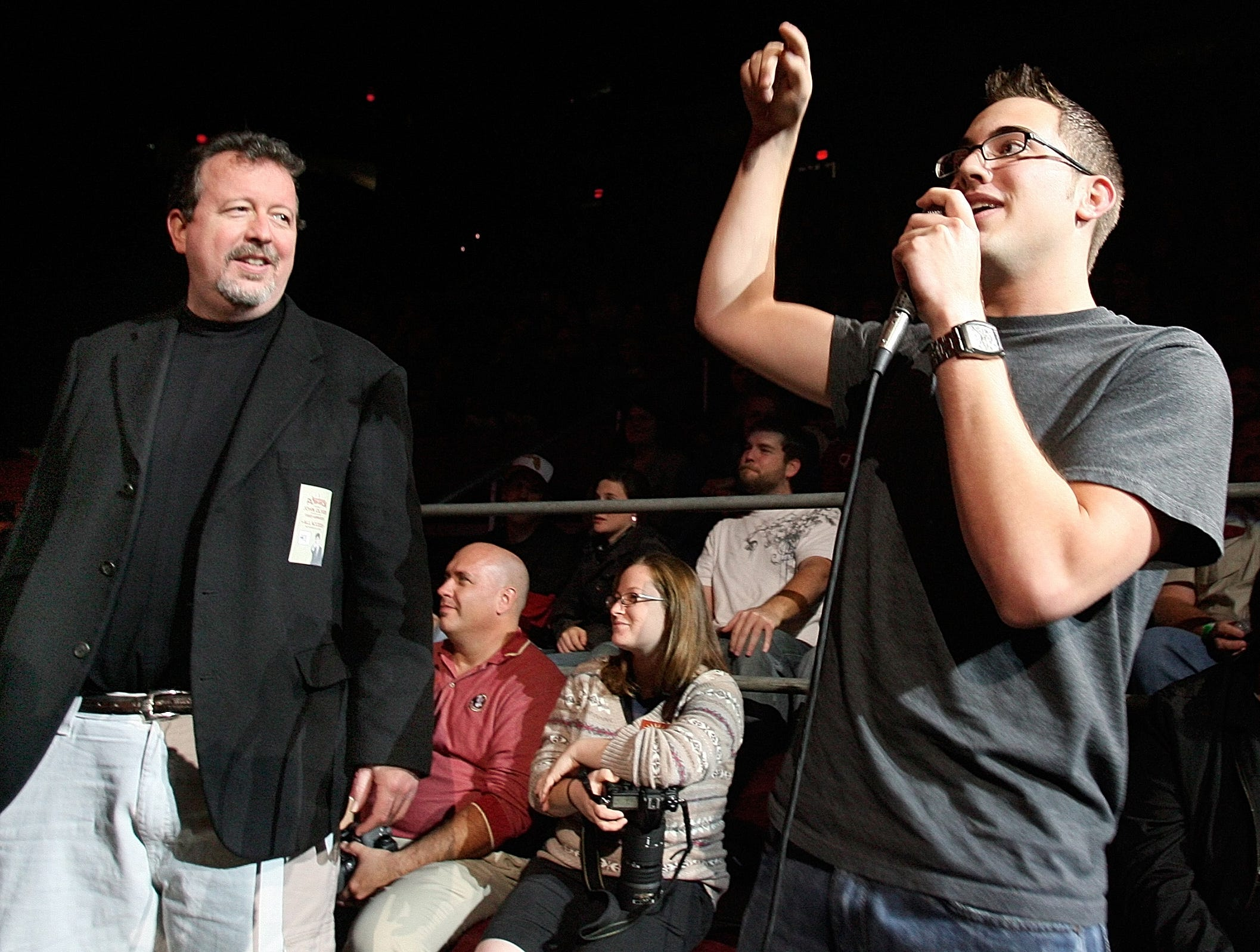 Tallahassee Democrat reporter Mark Hinson listens to an audience member as he asks a question of actor, comedian and musician Fred Armisen, a cast member on Saturday Night Live, who was performing during the FSU Pow Wow.