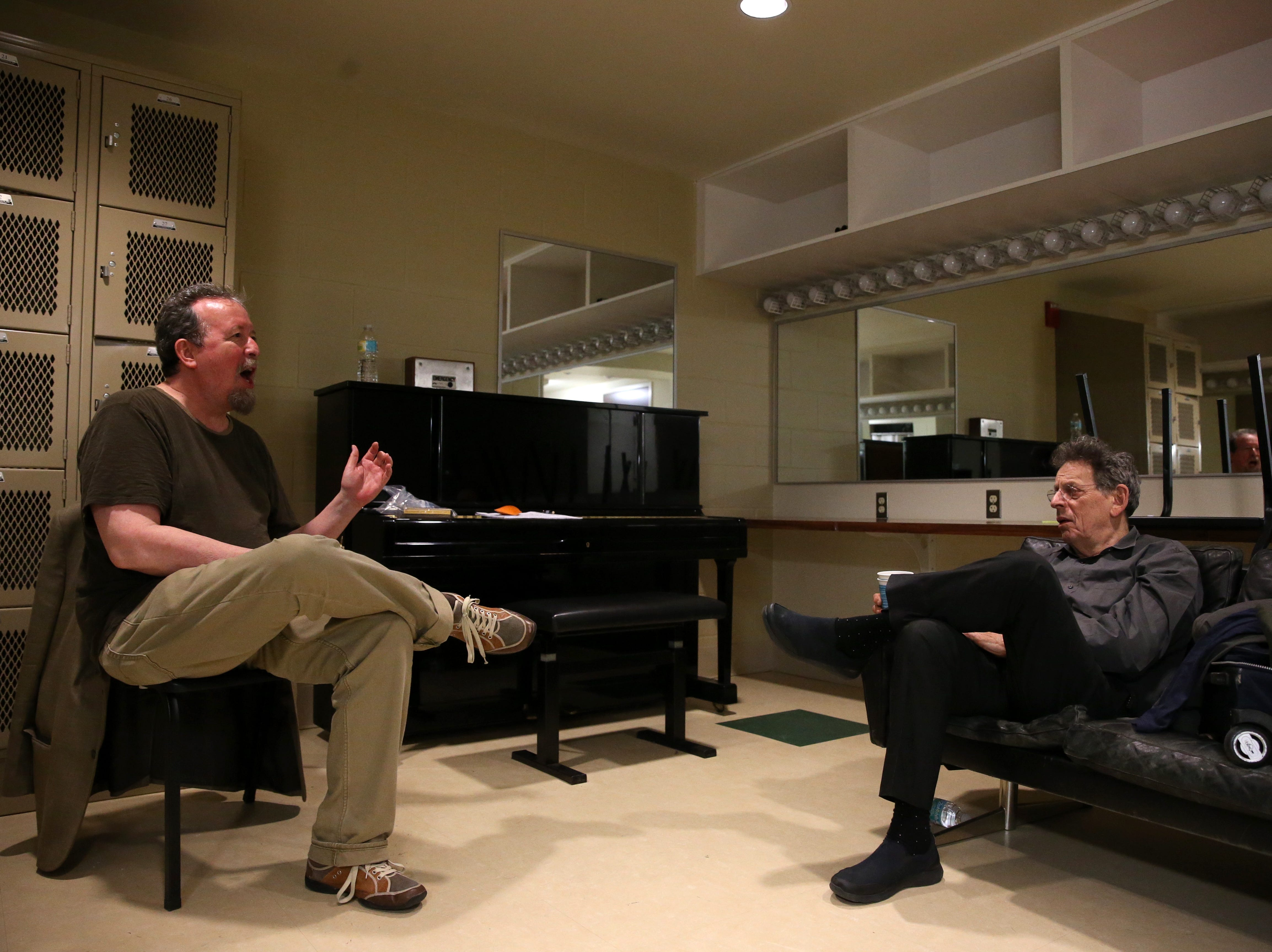 Democrat entertainment writer Mark Hinson chats with world-famous composer Philip Glass backstage before their Golden Tribe Lecture Series event at the Ruby Diamond Concert Hall on Tuesday, March 28, 2017.