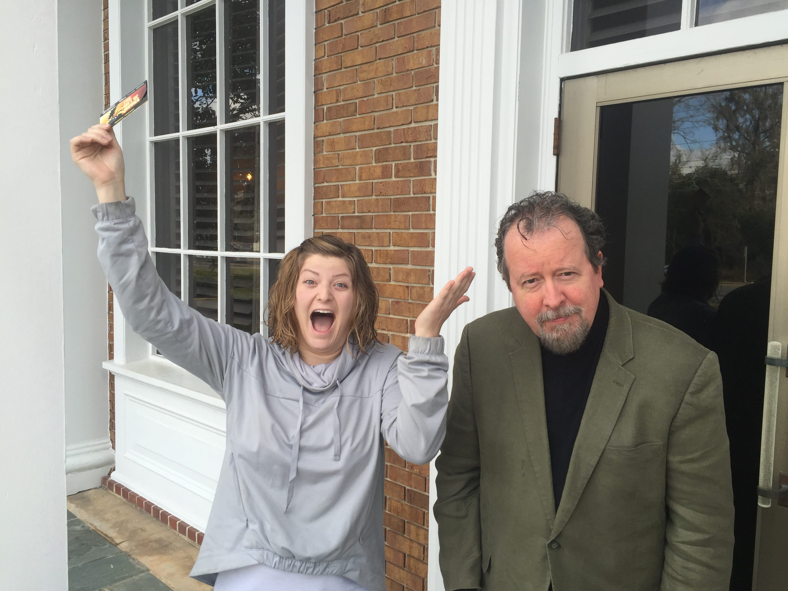 """Jamie Seidman-McDonnell celebrates her victory over the Democrat's film critic as the winner of the """"Beat Mark Hinson's Oscar Picks"""" contest."""