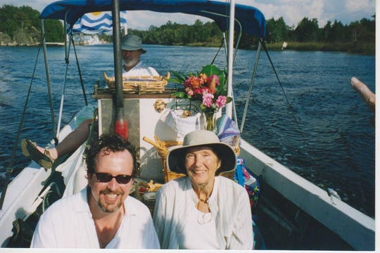 """Mark Hinson shares a ride on the Wakulla River with the star of """"The Creature From The Black Lagoon,"""" Julie Adams."""