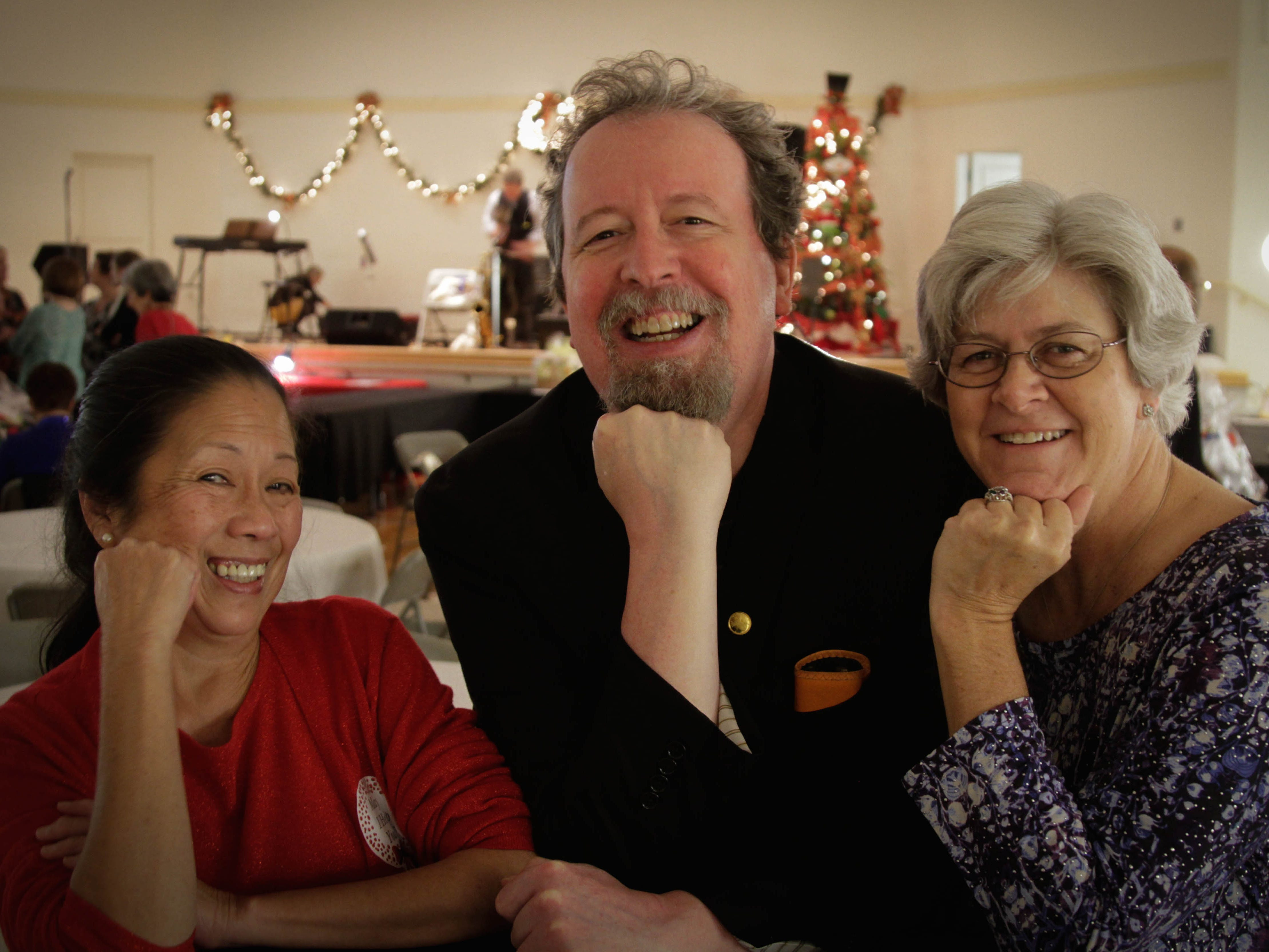 All smiles at Deck the Halls. From left, Aurora Hansen, Mark Hinson and Sheila Salyer.