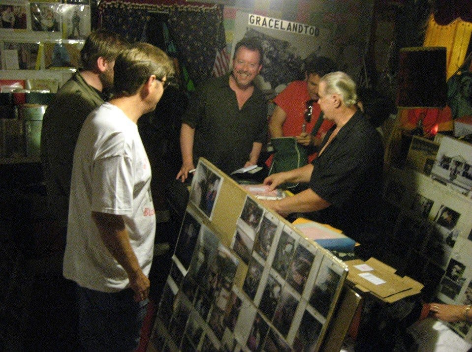 Elvis devotee and Graceland Too owner Paul McLeod, far right, gives columnist Mark Hinson, center, Forrest Watson, front left, and others a stream-of-consciousness tour of his mountain of memorabilia in 2007.