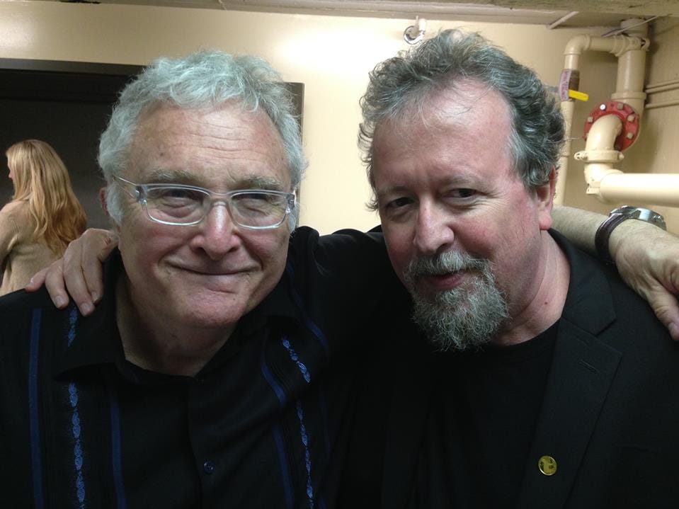 From a Facebook caption: Randy Newman and some dimwit.