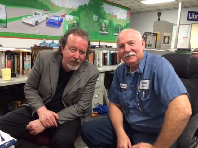 Tallahassee Democrat features columnist Mark Hinson and Tallahassee Democrat maintenance man Alton Lawrence hang out in the newsroom in 2014. The two natives of Marianna are cousins.