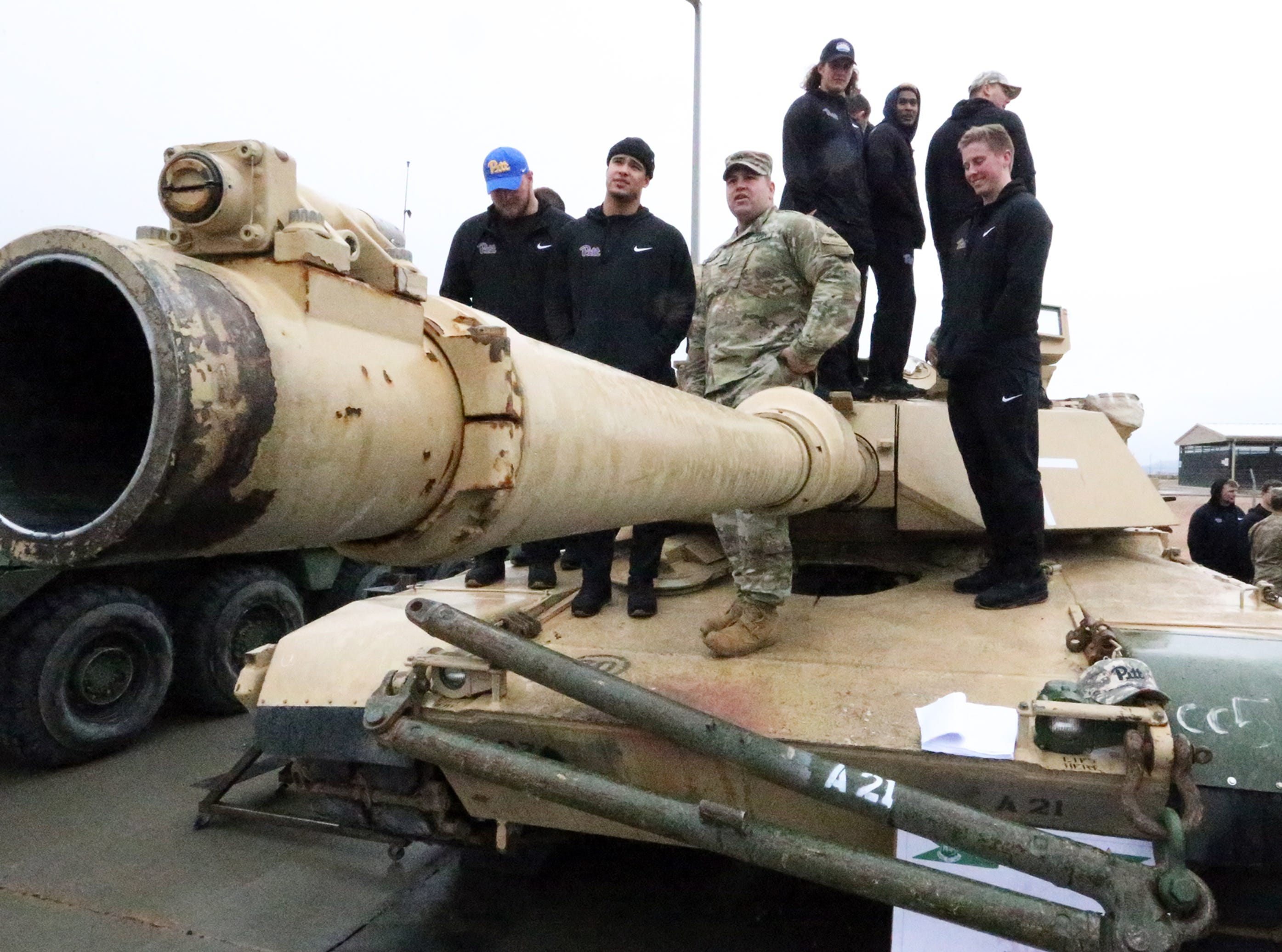 University of Pittsburgh players stand atop an M1A2 Abrams main battle tank during a visit to Fort Bliss Friday afternoon. The players also viewed a M2A3 Bradley Fighting Vehicle, a Stryker armored vehicle, a Patriot missile launcher and tried out simulators. The Stanford Cardinal football team was scheduled to visit the site following Pitt.