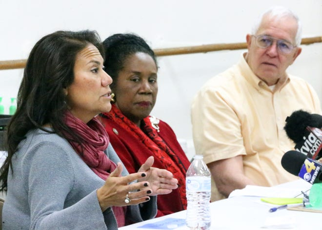 U.S. Rep. Sheila Jackson Lee, center, is flanked by U.S. Rep. elect Veronica Escobar and Ruben Garcia, director of Annunciation House at a press conference Saturday after a visit to the border area.