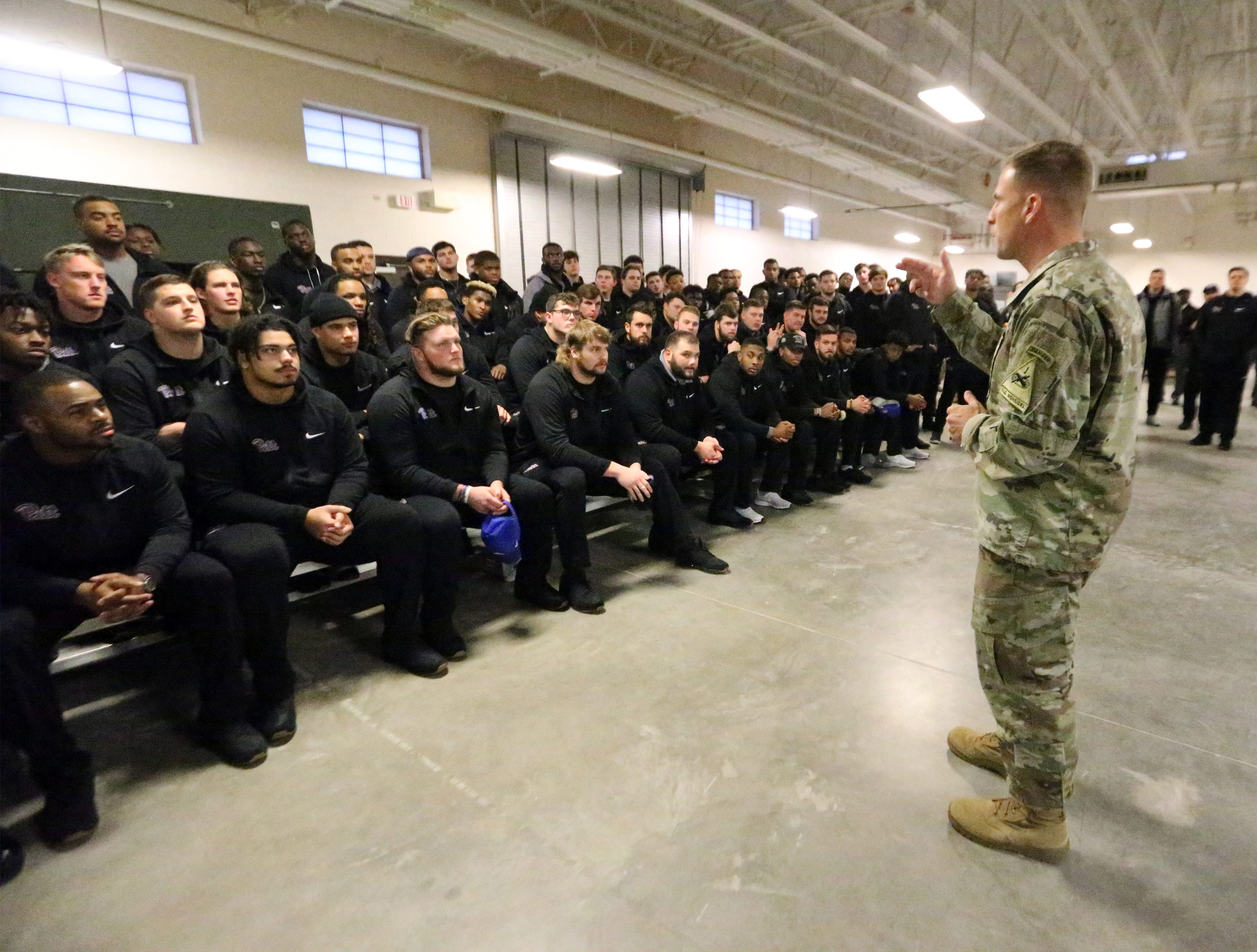 Brig. Gen. Scott Naumann, deputy commanding general of Fort Bliss greets the University of Pittsburgh football team upon their arrival at of the post's simulator facilities Friday.