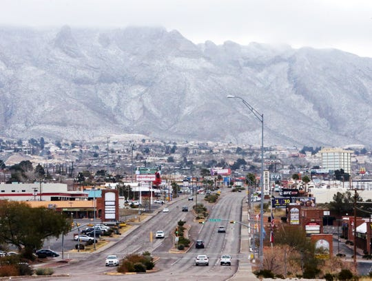 The Franklin Mountains are dusted with snow in this view from the 6900 block of N. Mesa Saturday. Winter weather hit the borderland overnight with chili temperatures and light snow.