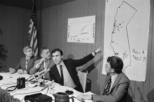 In this March 1, 1975, file photo, Gov. Jerry Brown points to a map where projects in California's clean water program are pinpointed during a news conference in Los Angeles.
