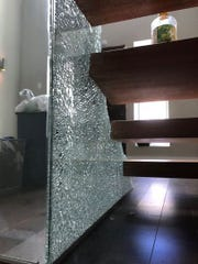 Broken glass at Nicko Feinberg's home that occurred during an unauthorized party.