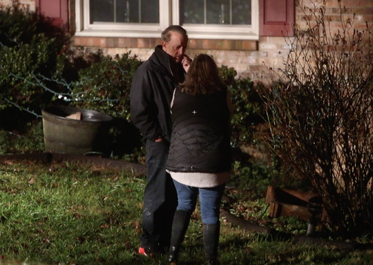 Former New Castle County county executive Tom Gordon talks to a neighbor outside his home after an explosion inside did an estimated $40,000 in damage, reported about 8 p.m. Friday.