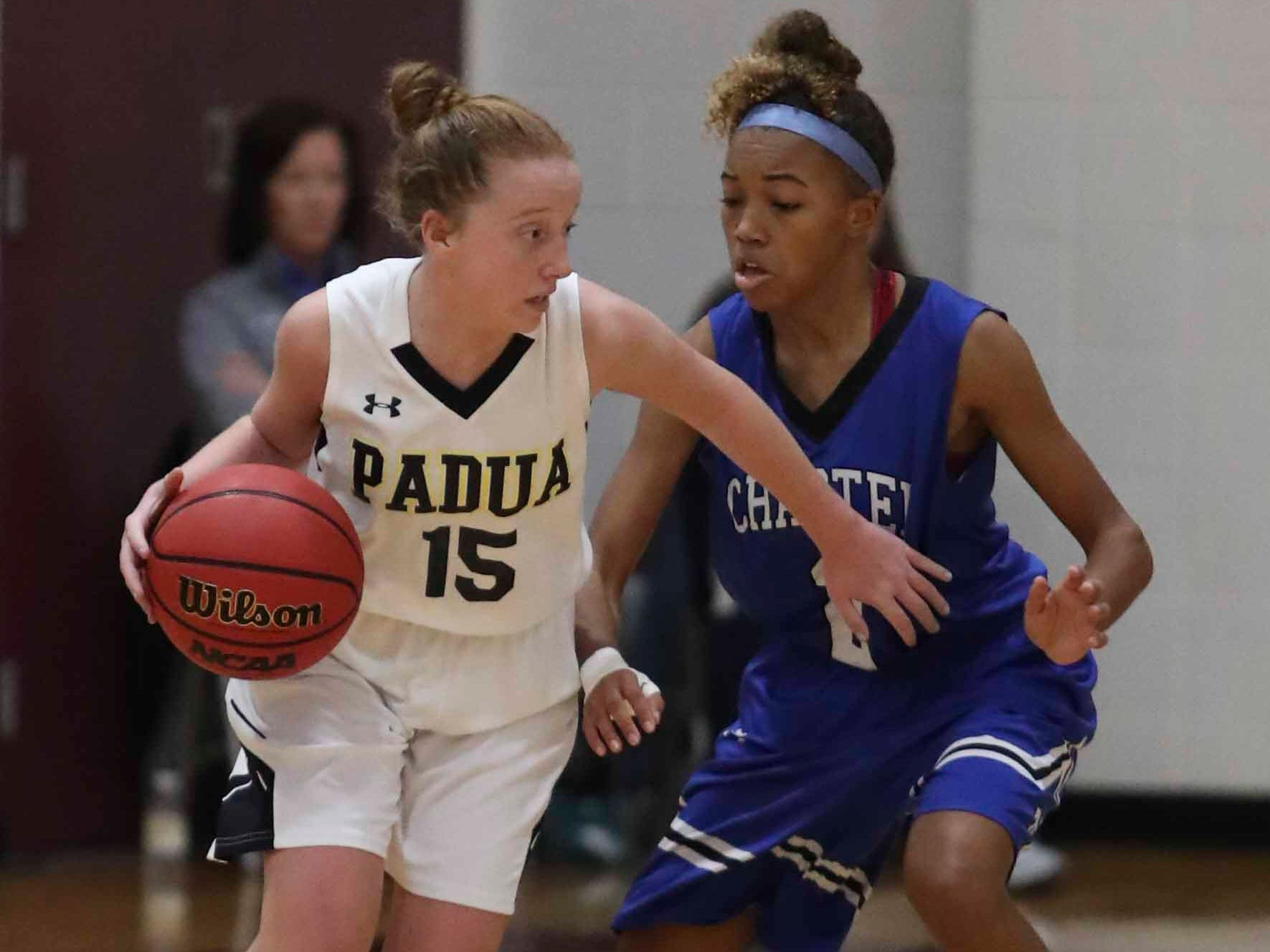 Padua's Haley Scott (left) controls against Charter's Nia Anderson in the second quarter of Padua's win in the Diamond State Classic Friday at the St. E Center.