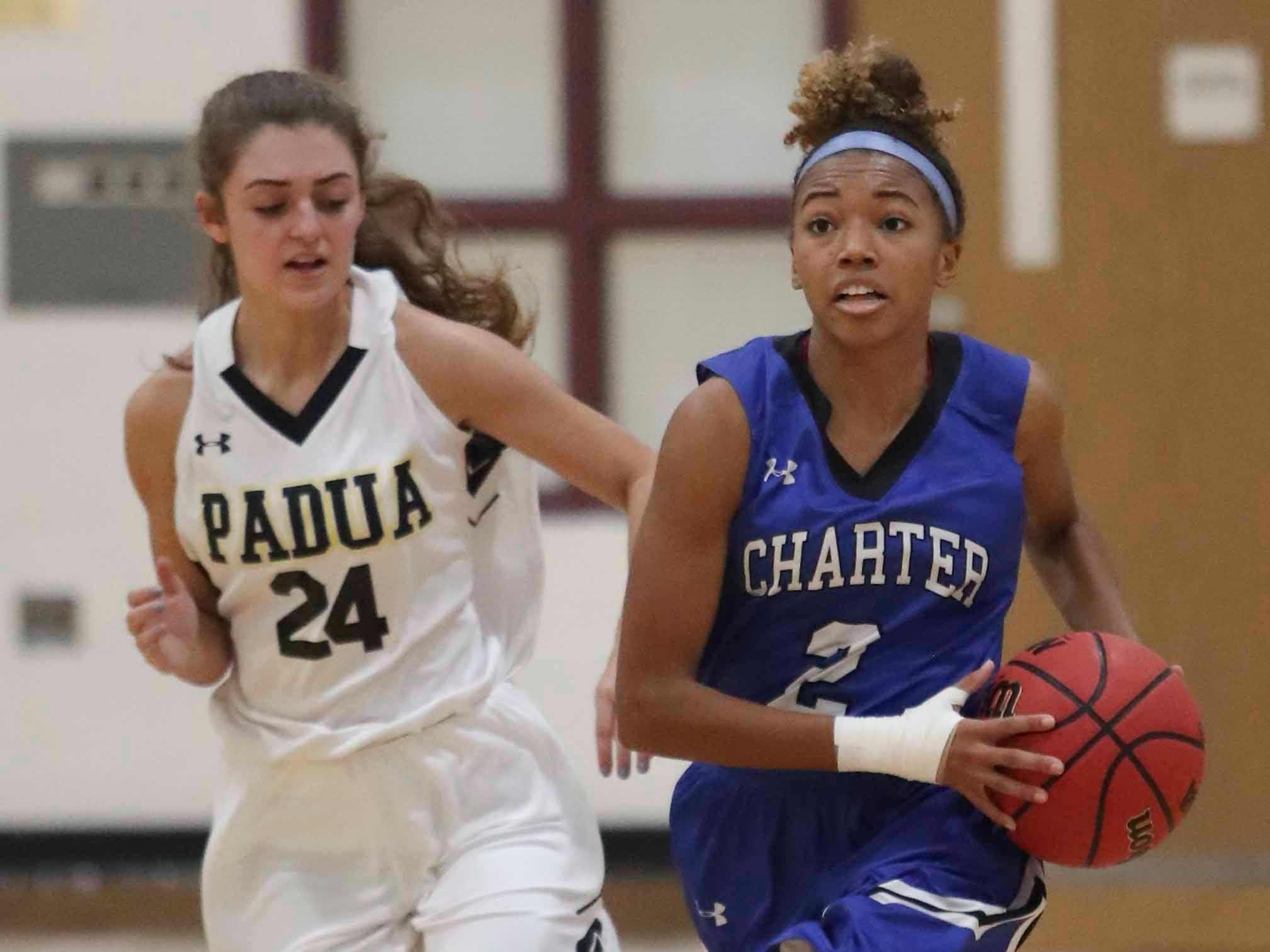 Charter's Nia Anderson moves ahead of Padua's Skylar Salvo in the second quarter of Padua's win in the Diamond State Classic Friday at the St. E Center.