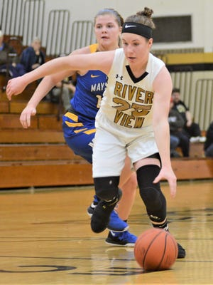 River View's Jessica Hartsock drives past Maysville's Bailee Smith in the Lady Bears' 64-52 win on Saturday.