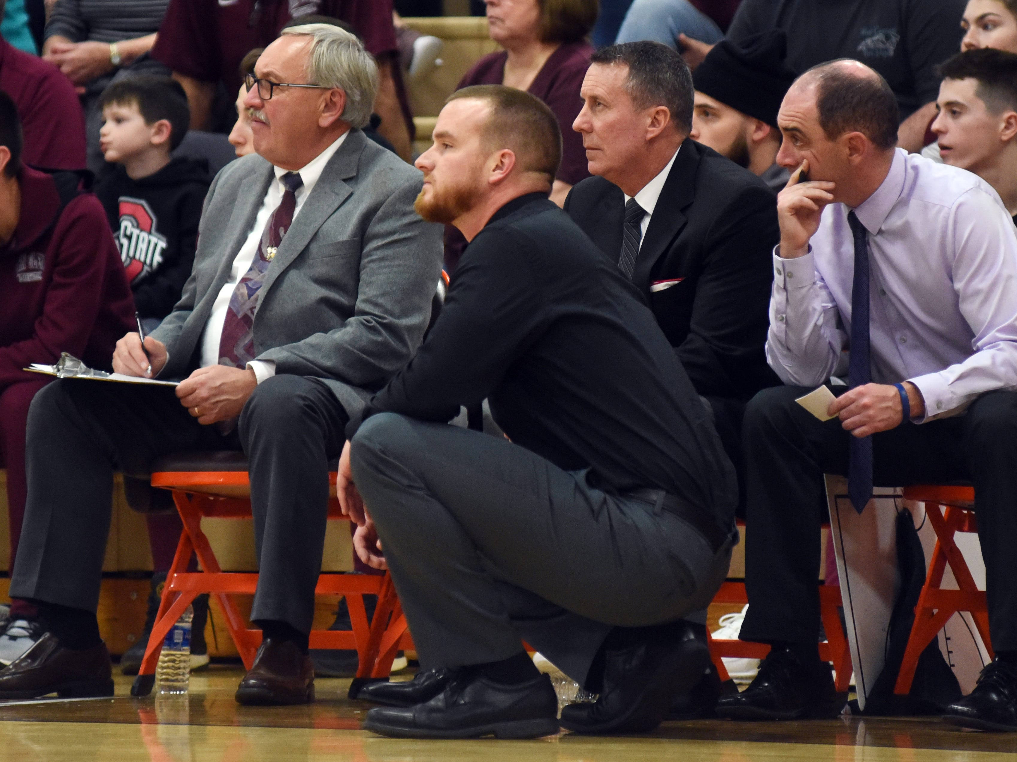 John Glenn coaches Paul Earich, left, T.J, Mitchell, Jeff Rinkes and Chad Orecchio watch the action against Meadowbrook on Friday night in Byesville.
