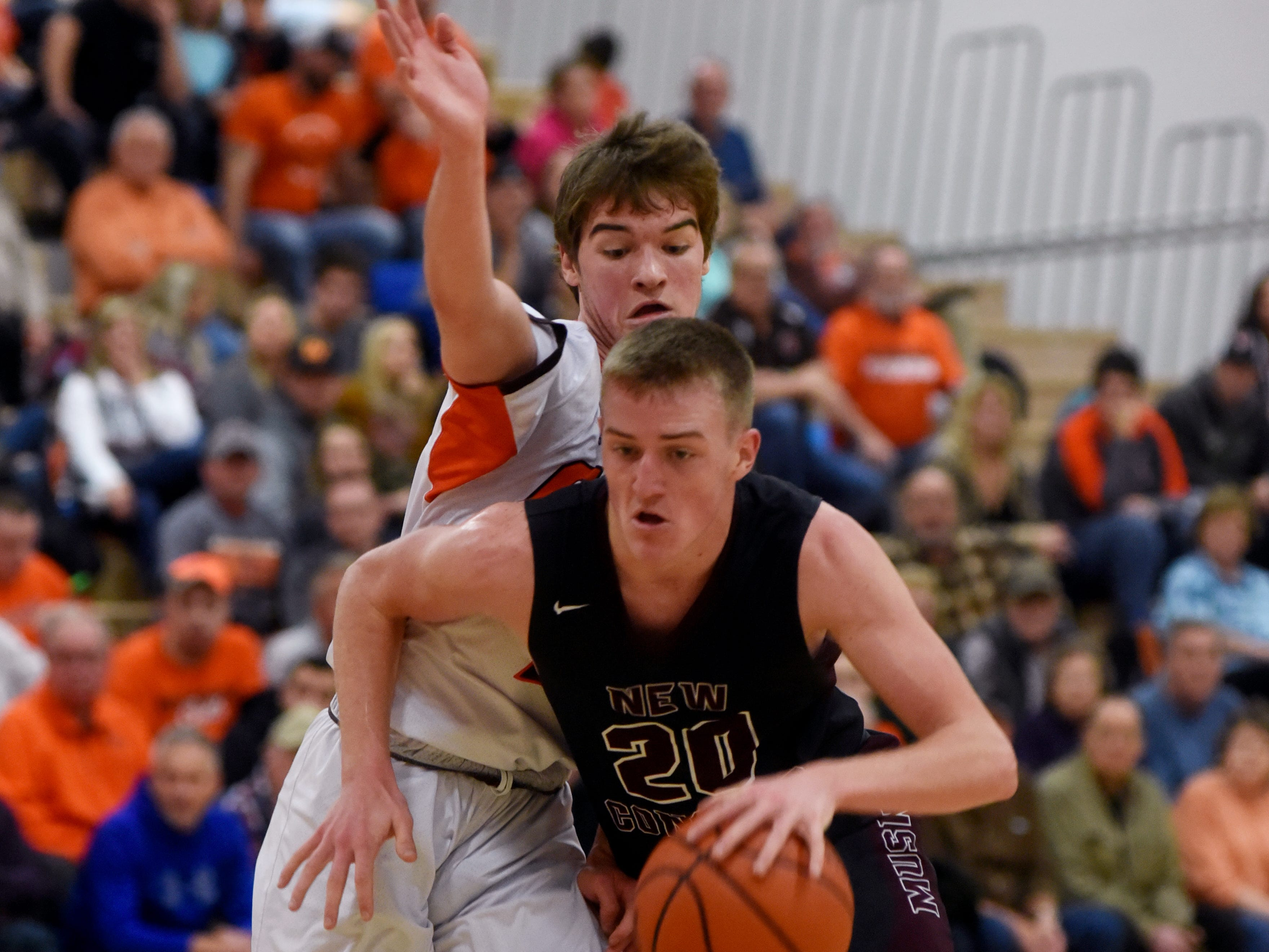 John Glenn's Parker Zachrich drives to the basket against Meadowbrook on Friday night in Byesville.
