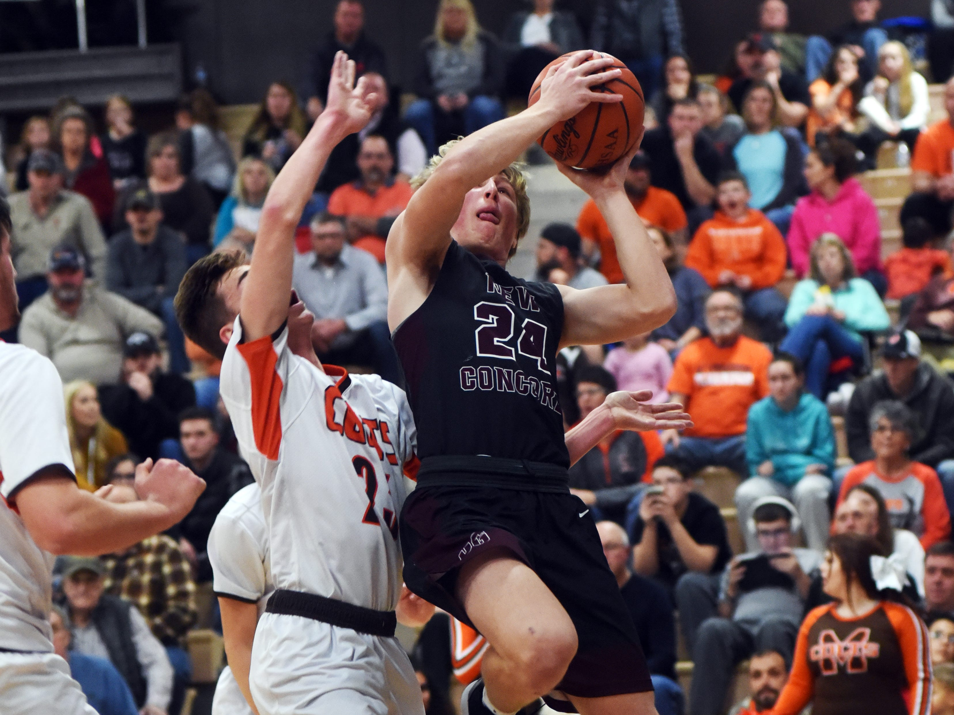 Reece Perkins, of John Glenn, goes up in the lane against Meadowbrook's Addy Black on Friday night in Byesville.