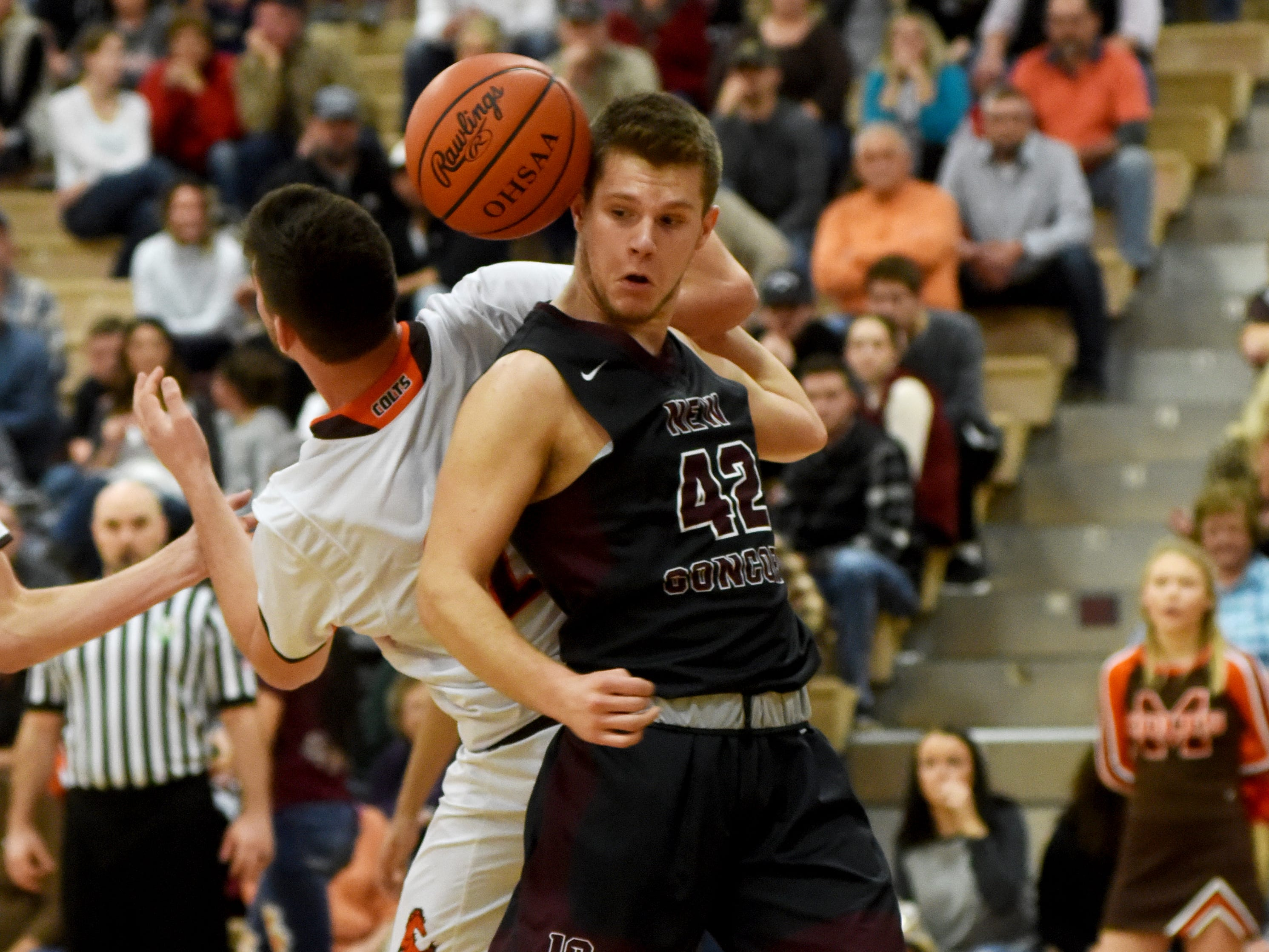 John Glenn's Ben Judd gets tangled up with Meadowbrook's Davis Black while trying to pull down a rebound in the first half of the Muskies' 61-38 loss on Friday night in Byesville.