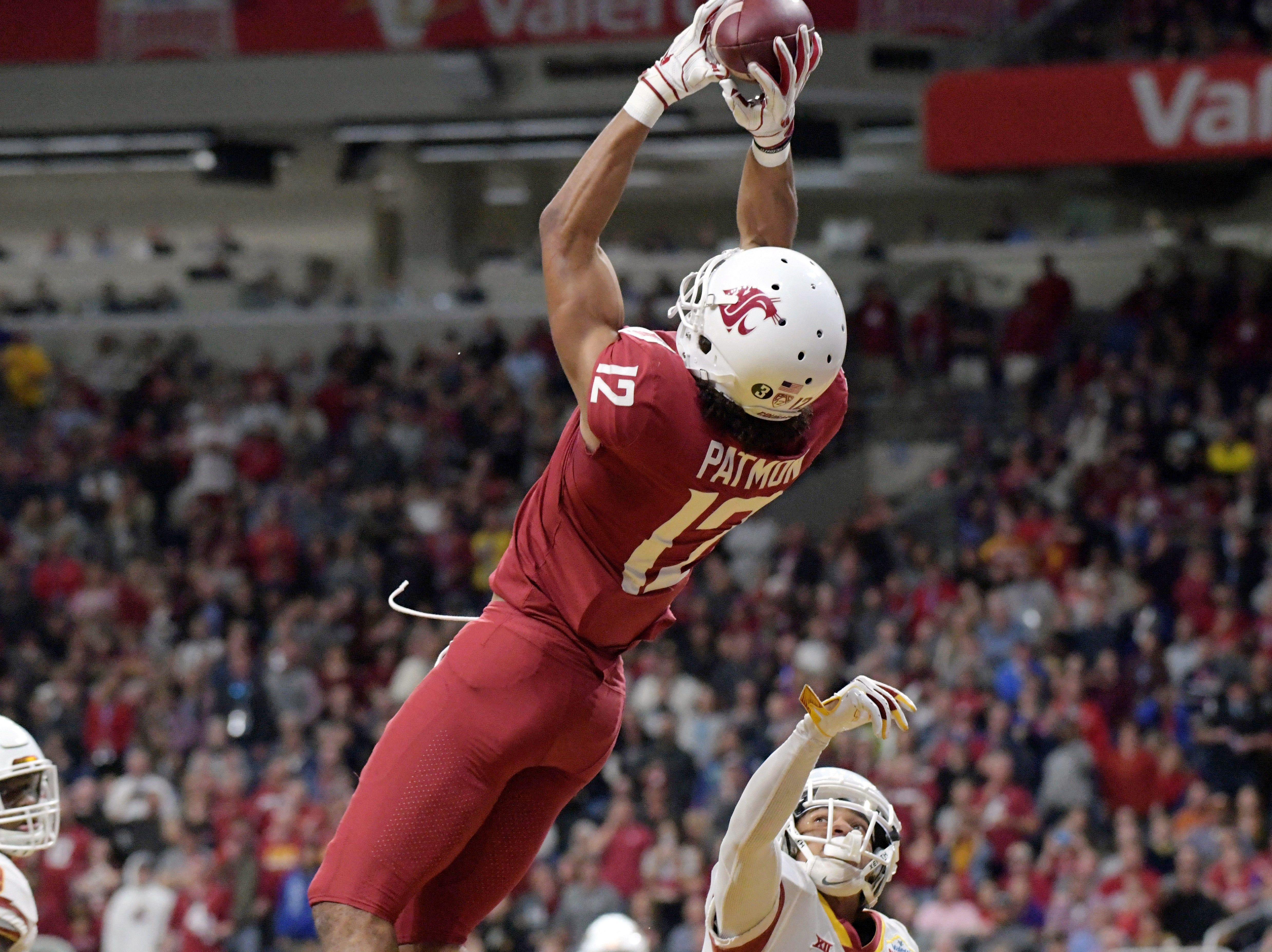 Washington State Cougars wide receiver Dezmon Patmon (12) catches a 9-yard touchdown pass in the second quarter against the Iowa State Cyclones in the Alamo Bowl.