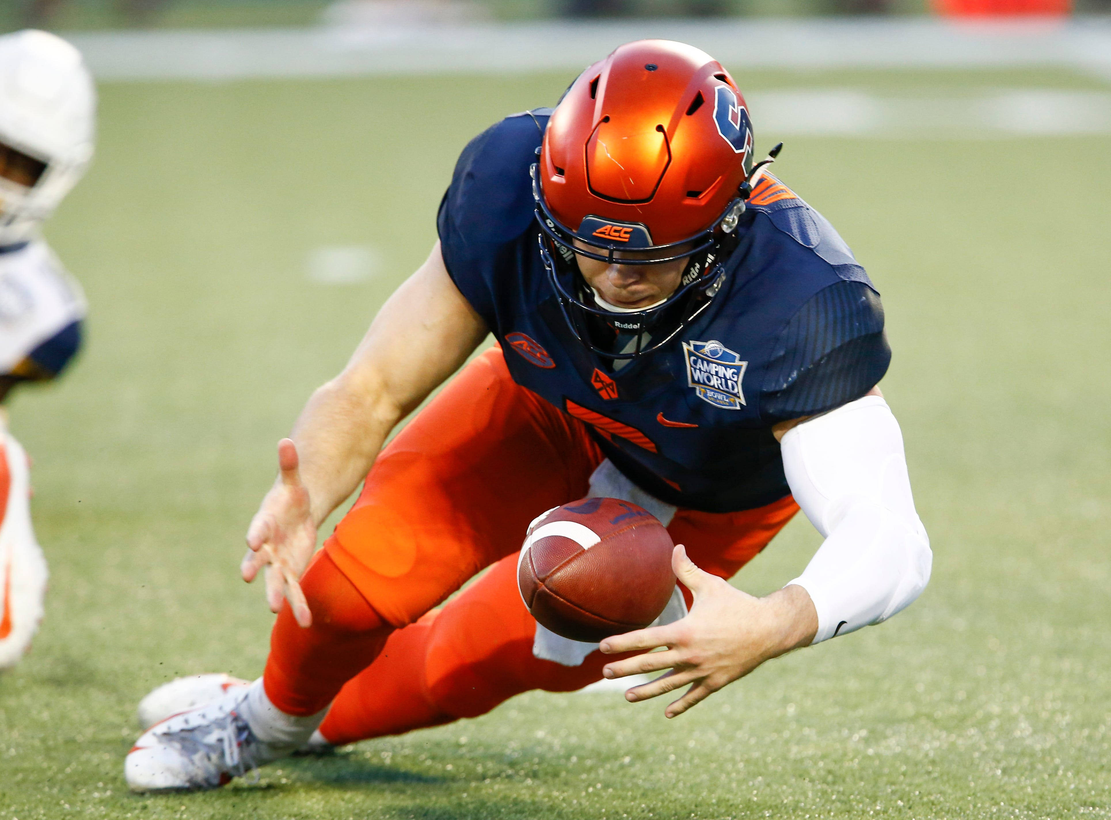 Syracuse Orange quarterback Eric Dungey (2) picks up a loose ball during the first quarter against the West Virginia Mountaineers in the Camping World Bowl.