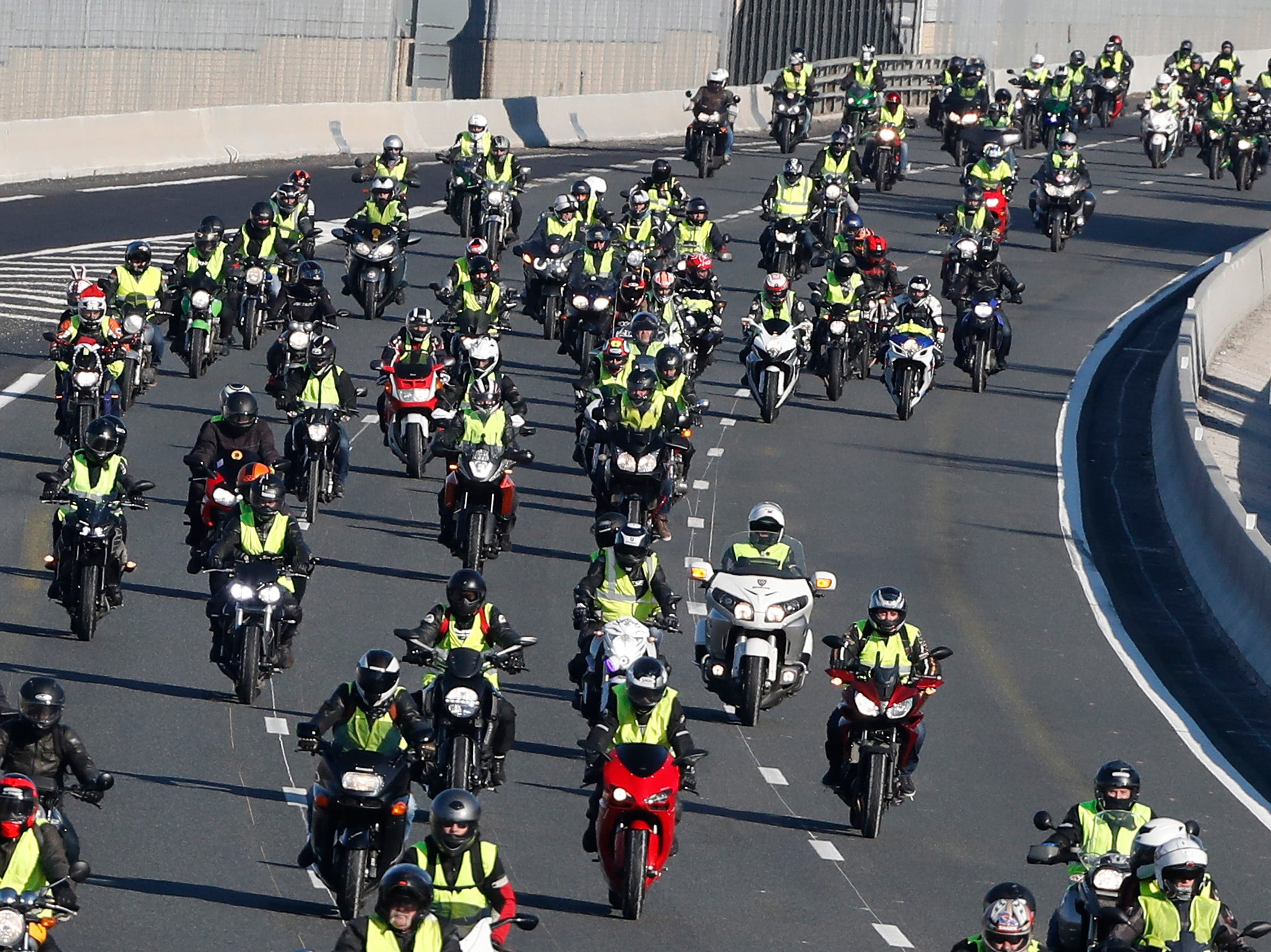 Bikers wearing yellow vests, as a symbol of French driver's and citizen's, demonstrate on the highway of Montpellier, Southern France on Dec. 29,2018. The so-called 'gilets jaunes' (yellow vests) are a protest movement, which reportedly has no political affiliation, is protesting across the nation over high fuel prices.