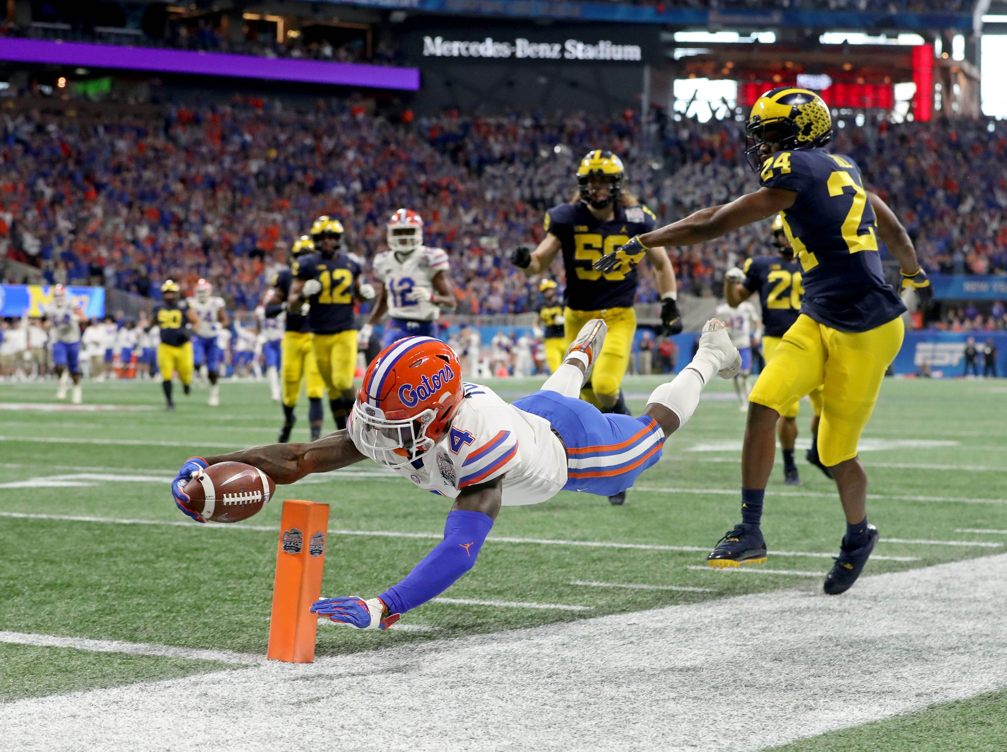 Florida Gators running back Kadarius Toney (4) dives for the end zone against the Michigan Wolverines during the third quarter of the Peach Bowl.