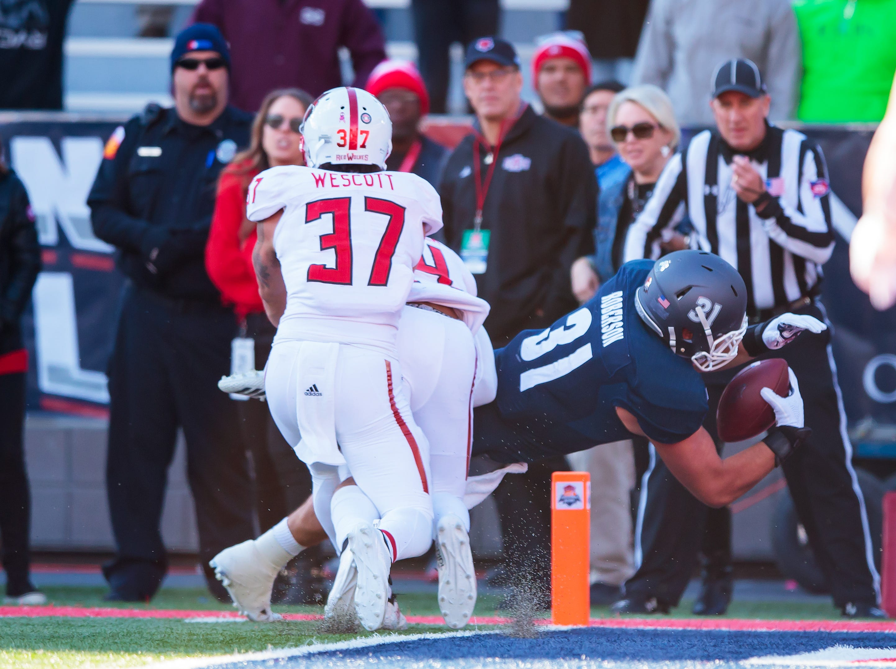 Nevada Wolf Pack tight end Reagan Roberson (31) dives into the end zone to score the winning touchdown in overtime against the Arkansas State Red Wolves in the Arizona Bowl.