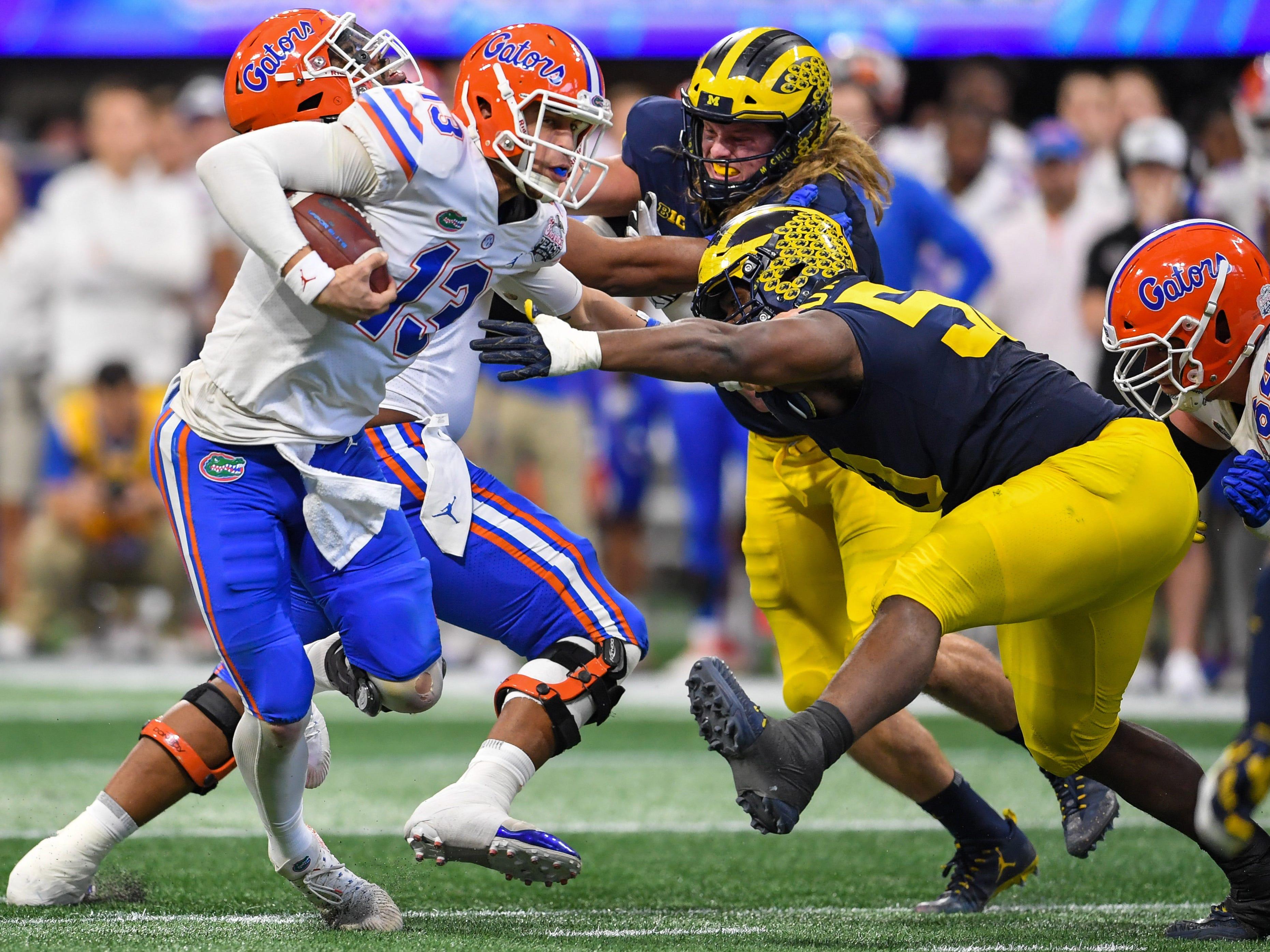 Florida quarterback Feleipe Franks runs against Michigan in the first half in the 2018 Peach Bowl at Mercedes-Benz Stadium.