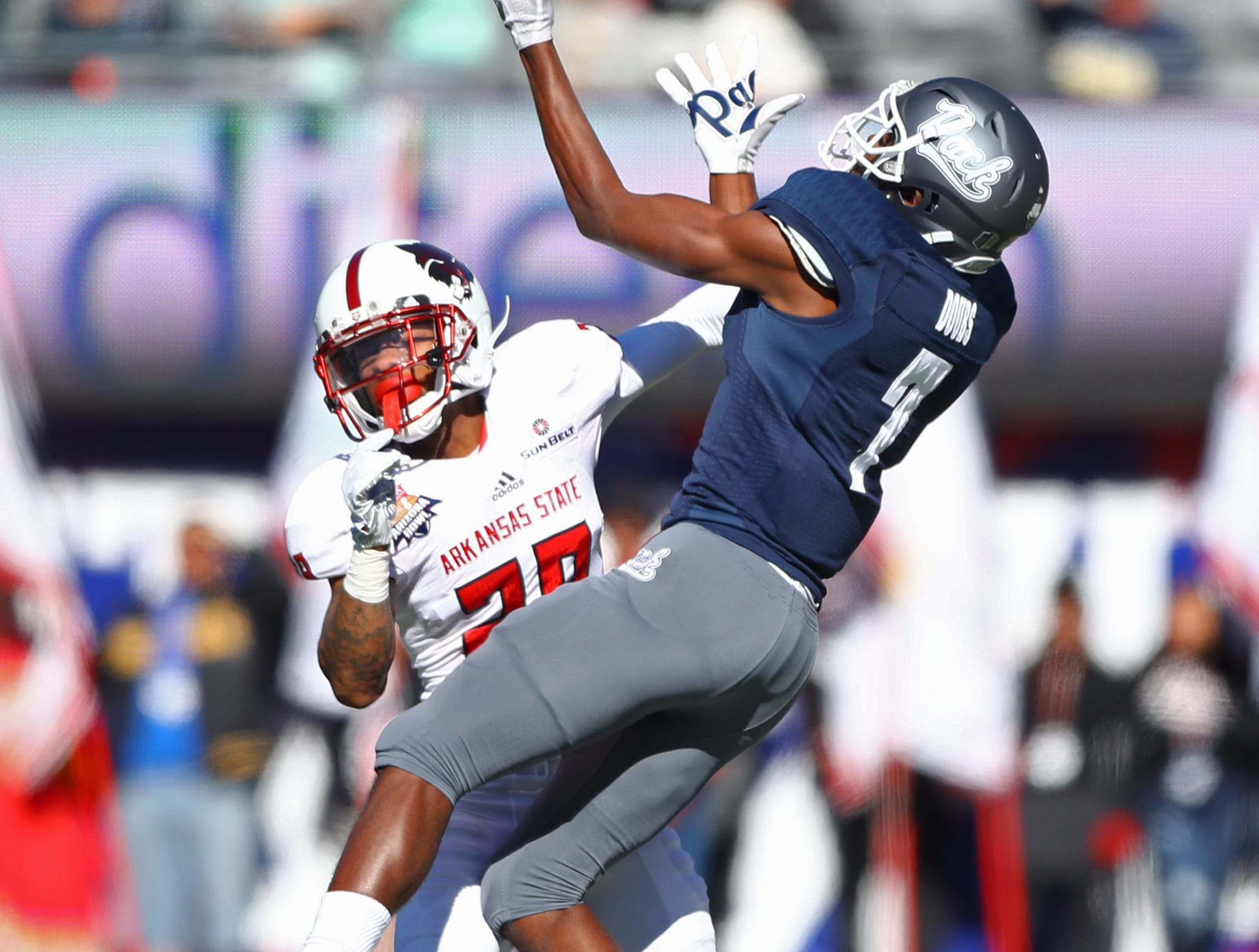 Arkansas State Red Wolves defensive back Brandon Byner (28) breaks up a pass intended for Nevada Wolf Pack wide receiver Romeo Doubs (7) in the first half of the Arizona Bowl.