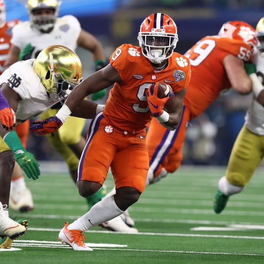 Clemson running back Travis Etienne runs with the ball against Notre Dame during the first half of the Cotton Bowl.